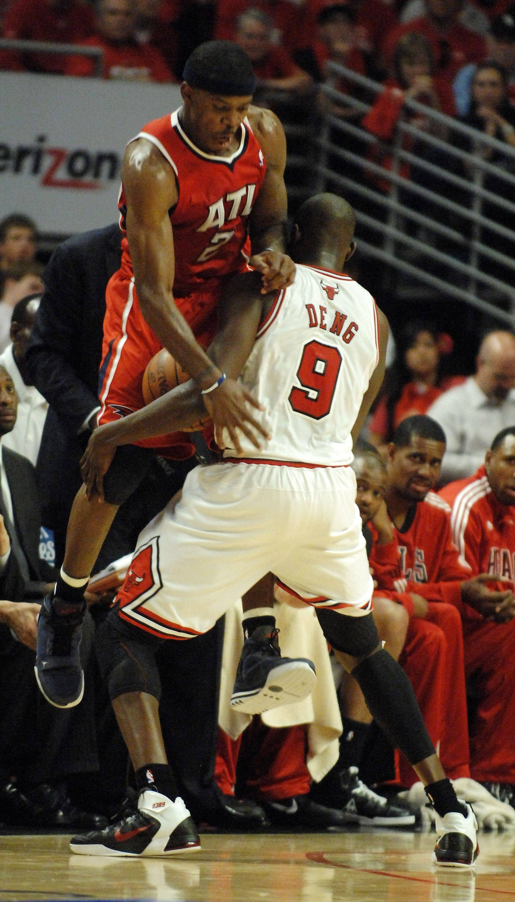 Chicago Bulls forward Luol Deng strips the ball from Atlanta Hawks guard Joe Johnson during game 5 Tuesday.