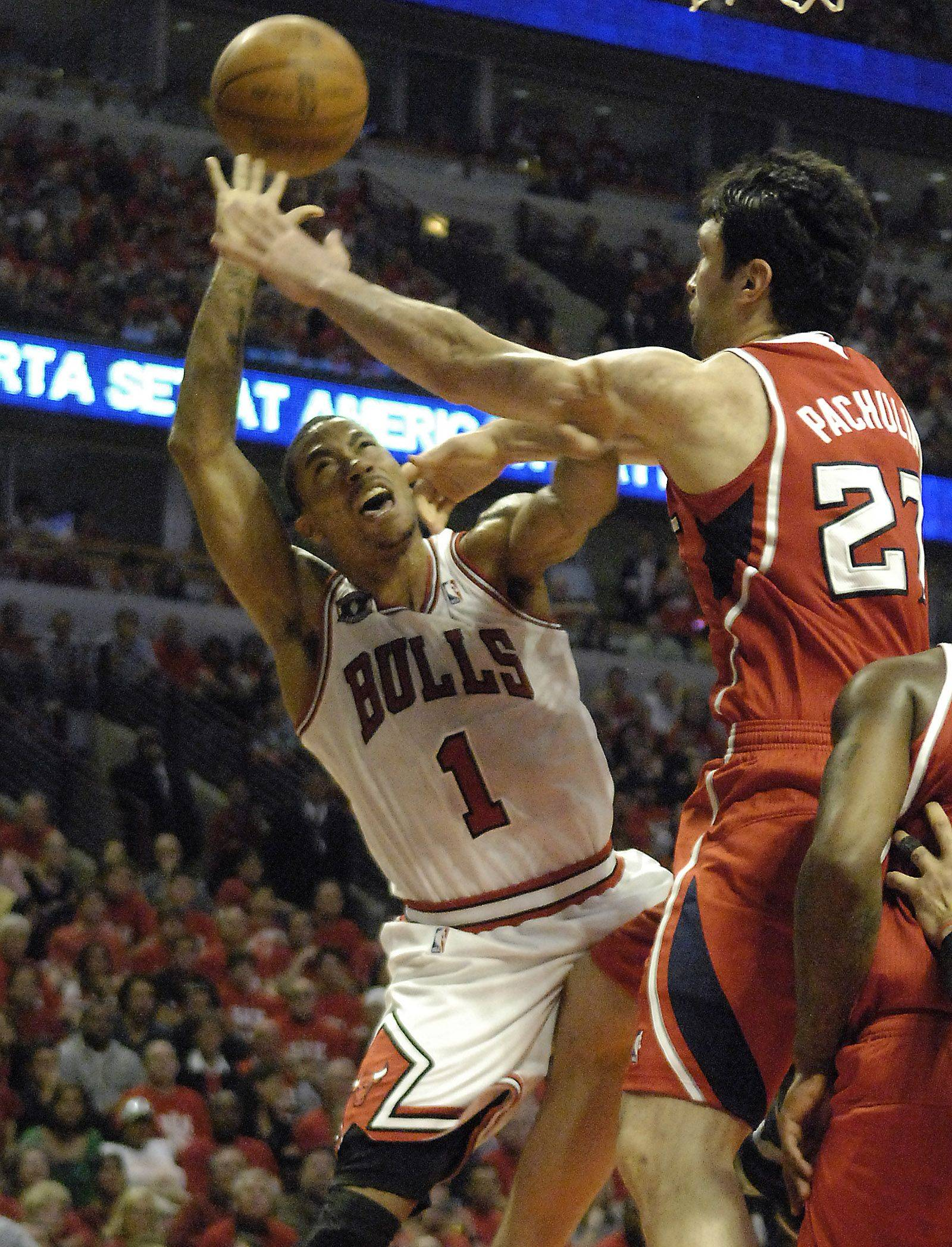 Chicago's Derrick Rose is fouled by Atlanta's Zaza Pachulia in game 5 Tuesday.
