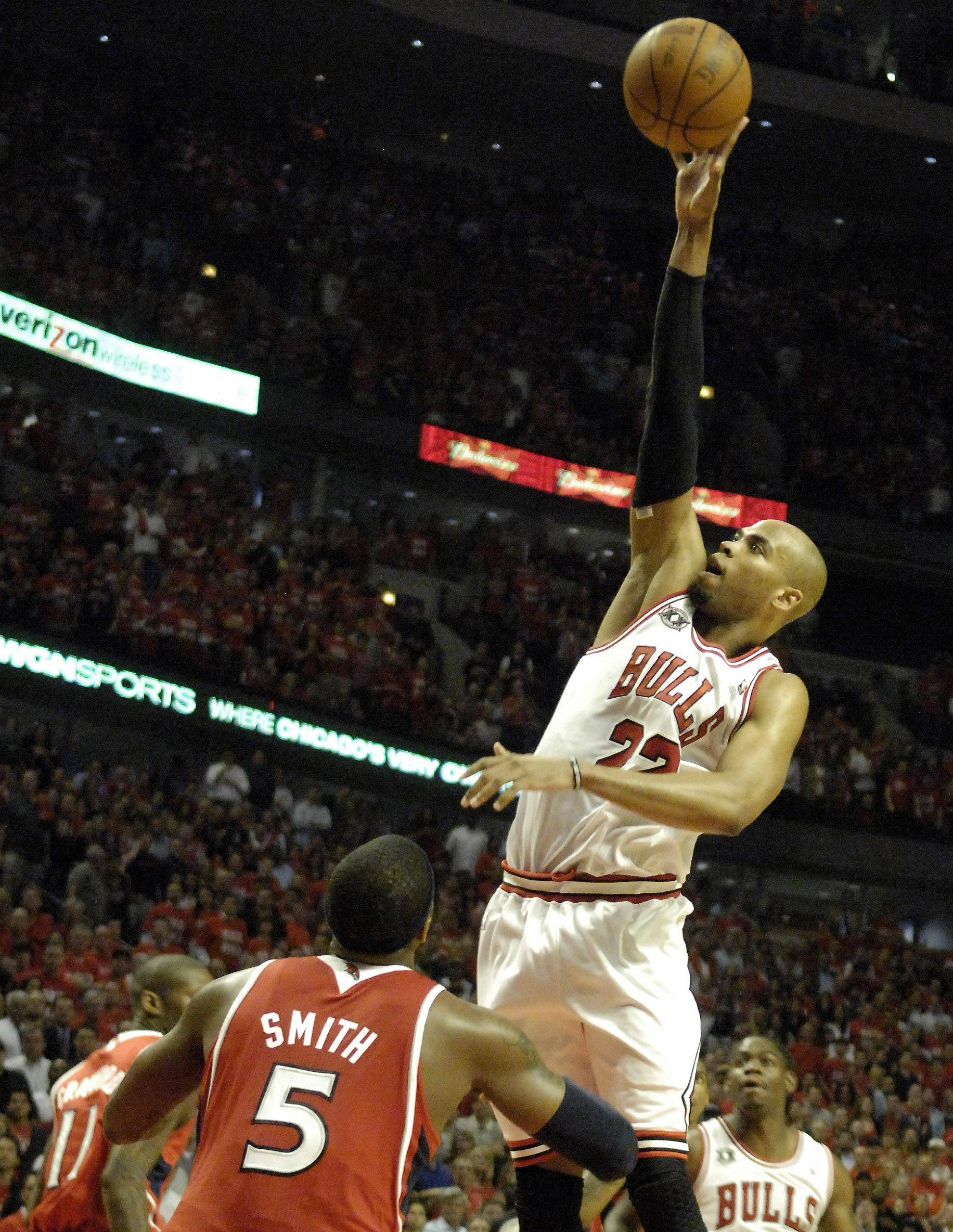 Forward Taj Gibson goes up high and scores on a jumper over Atlanta's Josh Smith at the United Center in Chicago Tuesday.