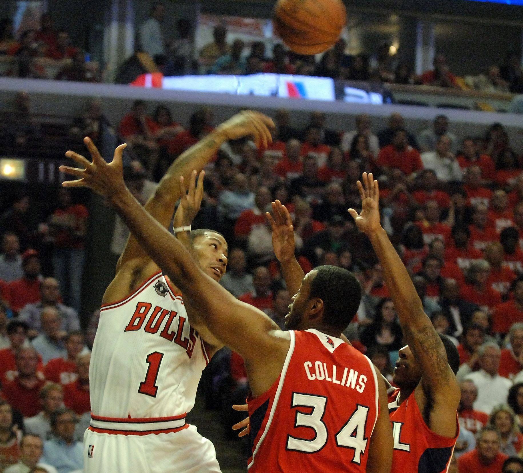 Chicago Bulls point guard Derrick Rose passes out of a double-team Tuesday.