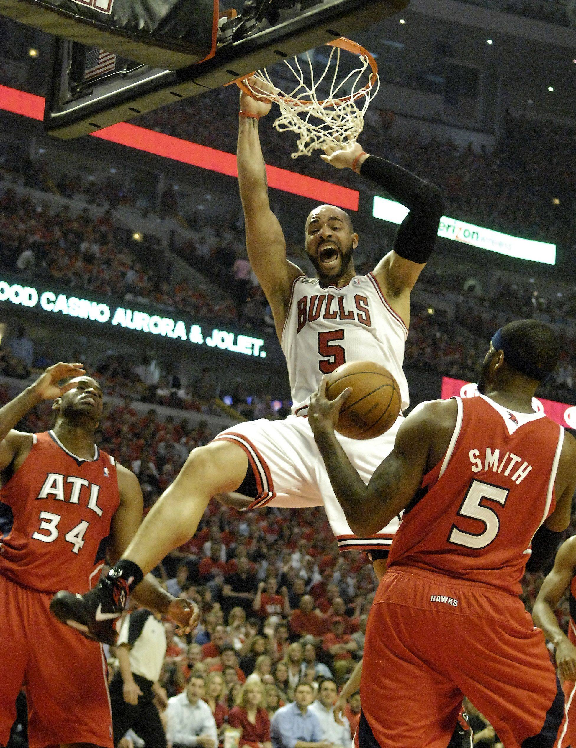 Chicago Bulls power forward Carlos Boozer throws down a dunk in front of Atlanta Hawks power forward Josh Smith during game 5 Tuesday.
