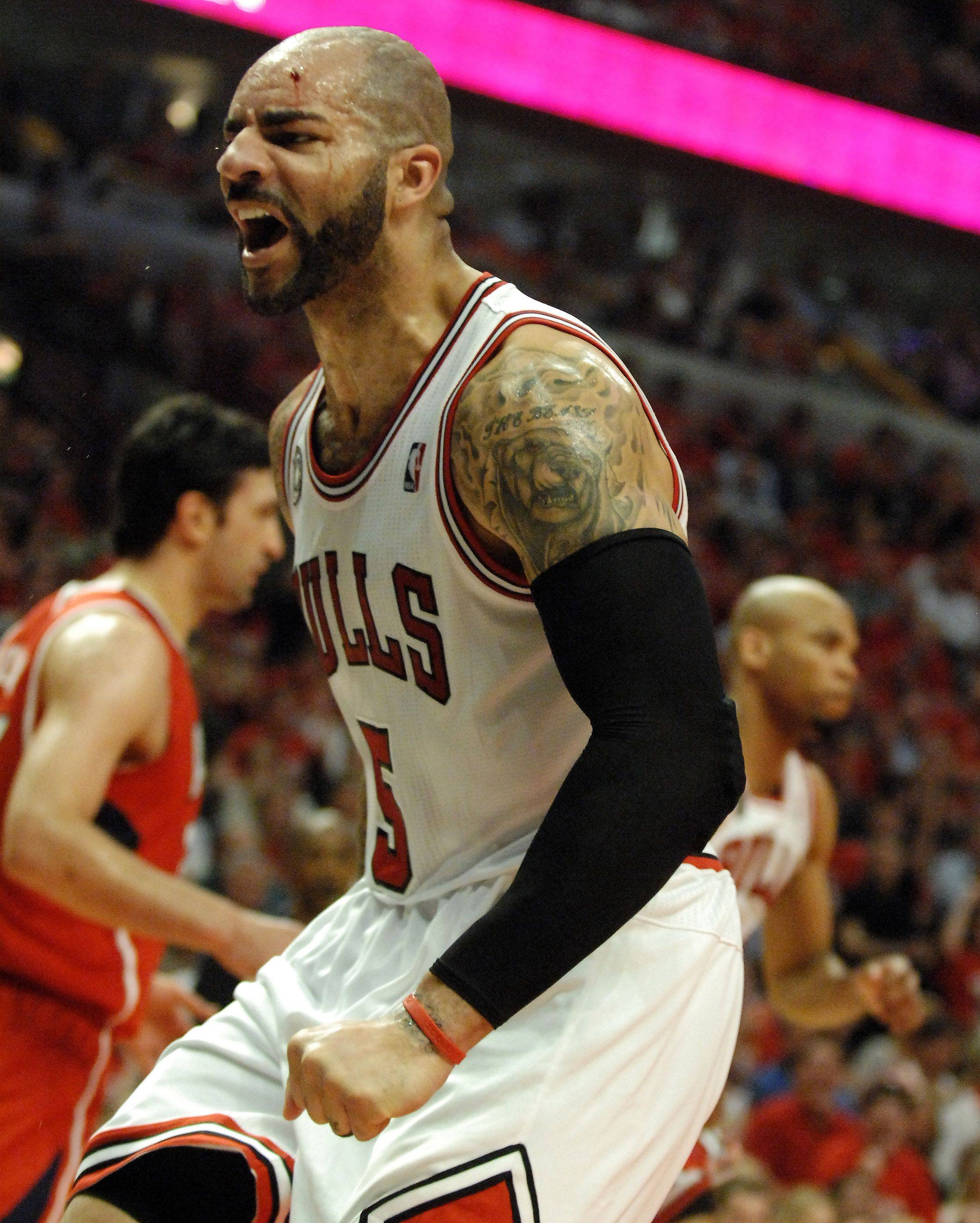 Bulls power forward Carlos Boozer starts to bleed during game 5 at the United Center.
