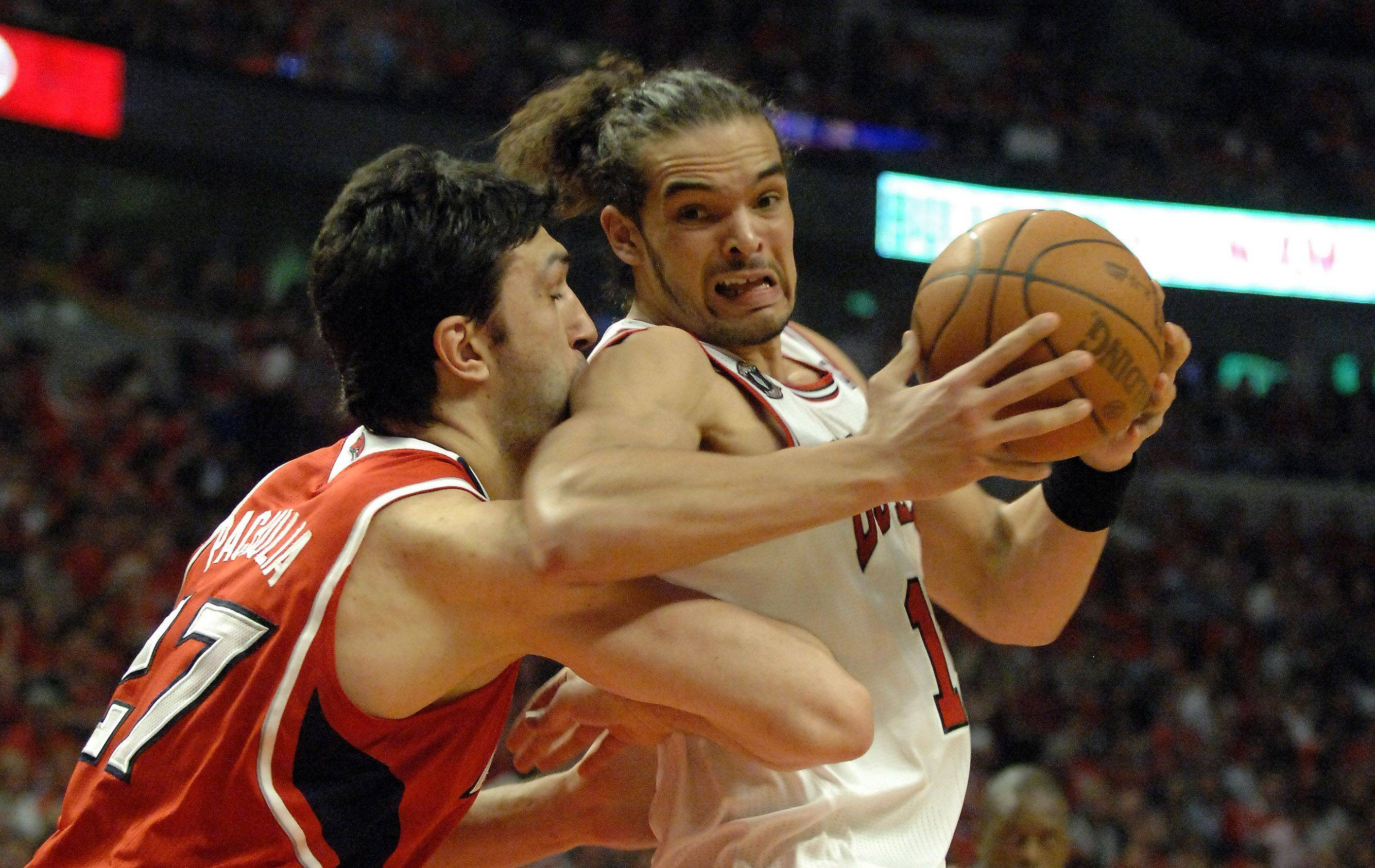 Chicago Bulls center Joakim Noah tries to back in against Atlanta Hawks center Zaza Pachulia at the United Center.