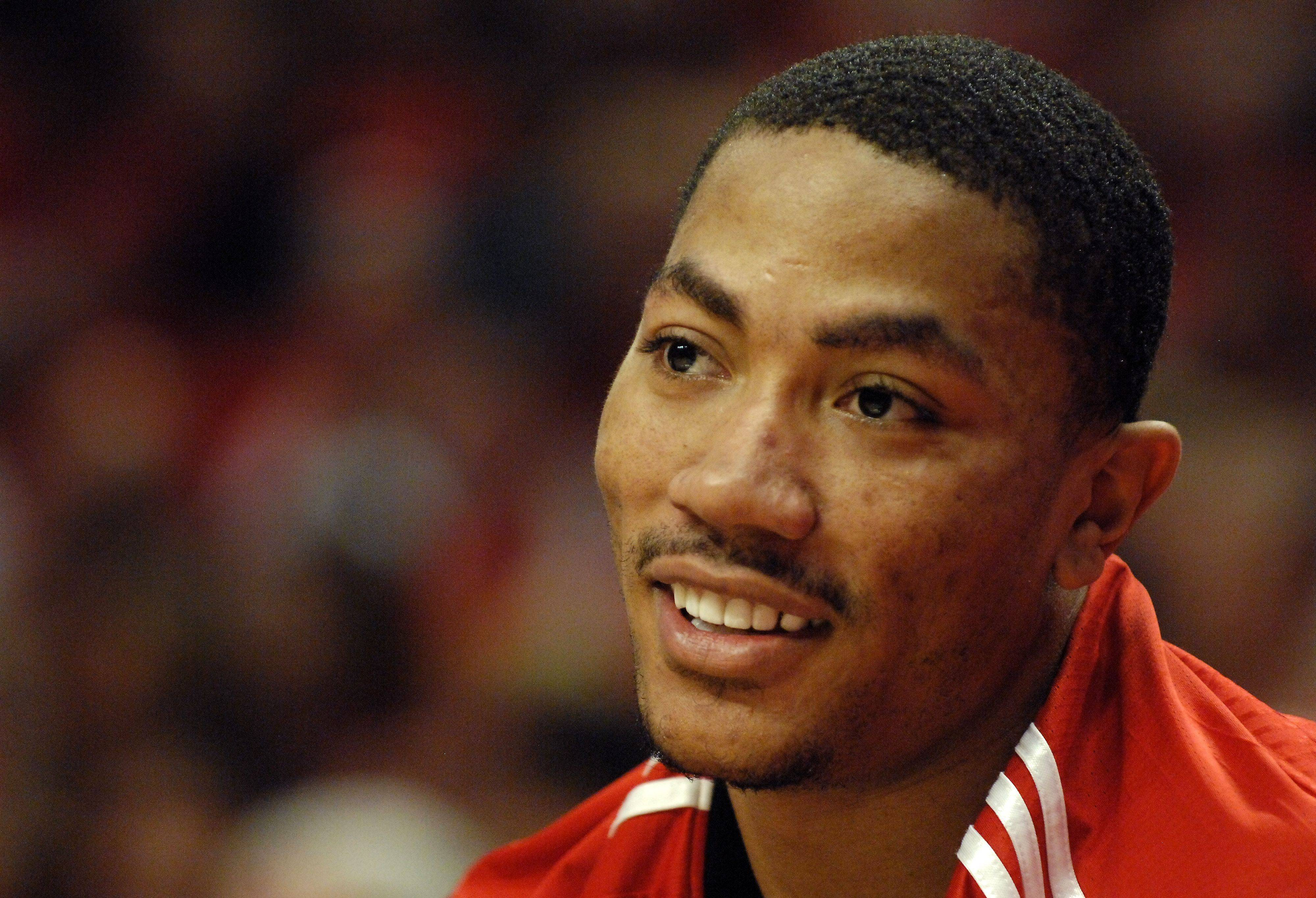 Derrick Rose smiles from the bench during game 5 of the NBA Eastern Conference semifinals at the United Center in Chicago Tuesday.