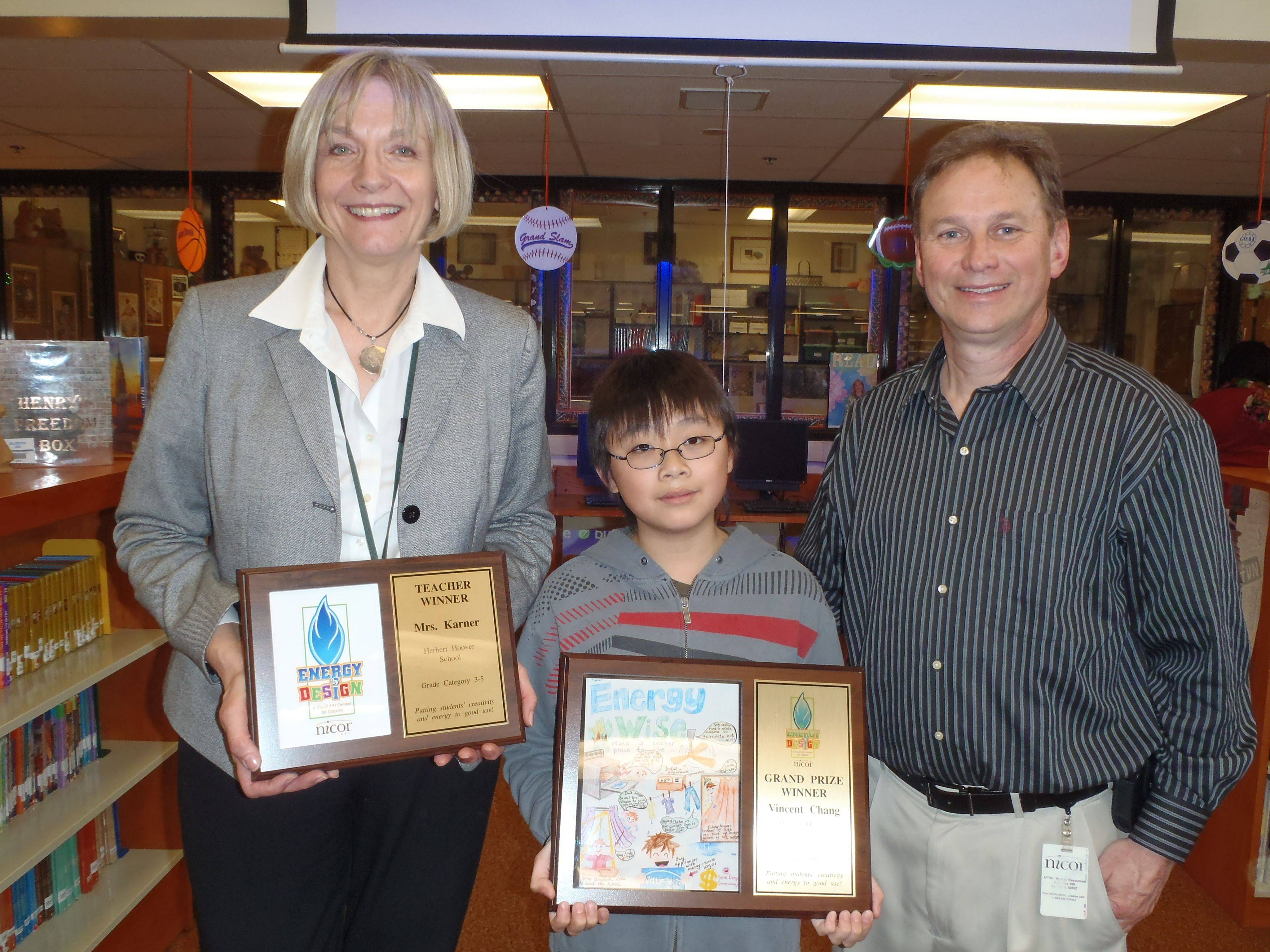 Pictured, from left, Rose Garner, Herbert Hoover School fifth grade teacher; Vincent Chang, Grand Prize winner, fifth-grade student; and Jim Tansor, senior community relations director for Nicor Gas.