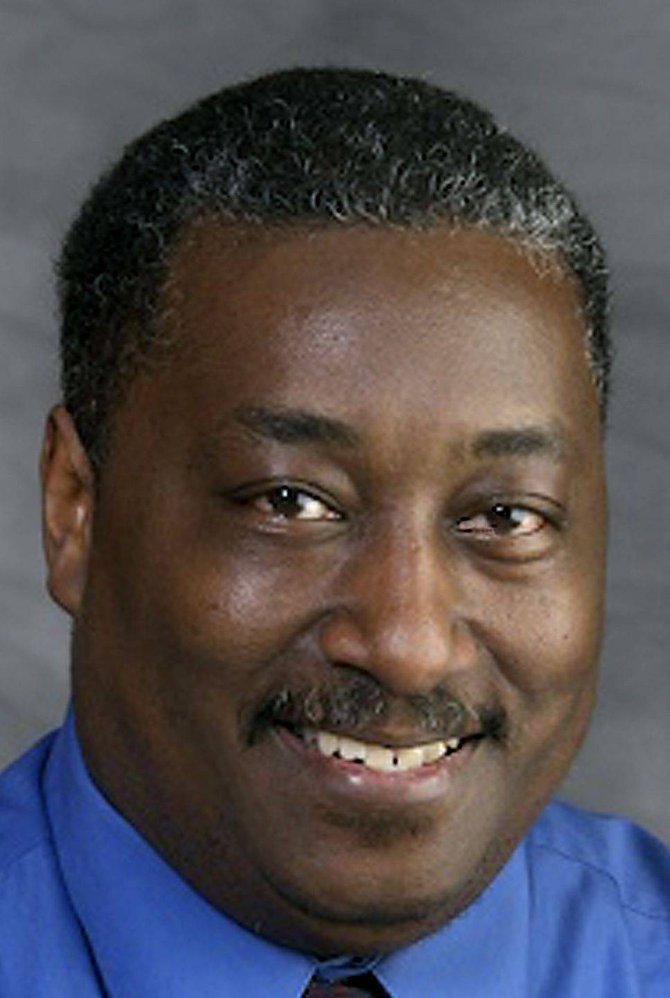 Kane County board member Donnell Collins, of Aurora, was absent from 42 percent of meetings in 2010. Collins cites conflicts with his job as a sports photographer.