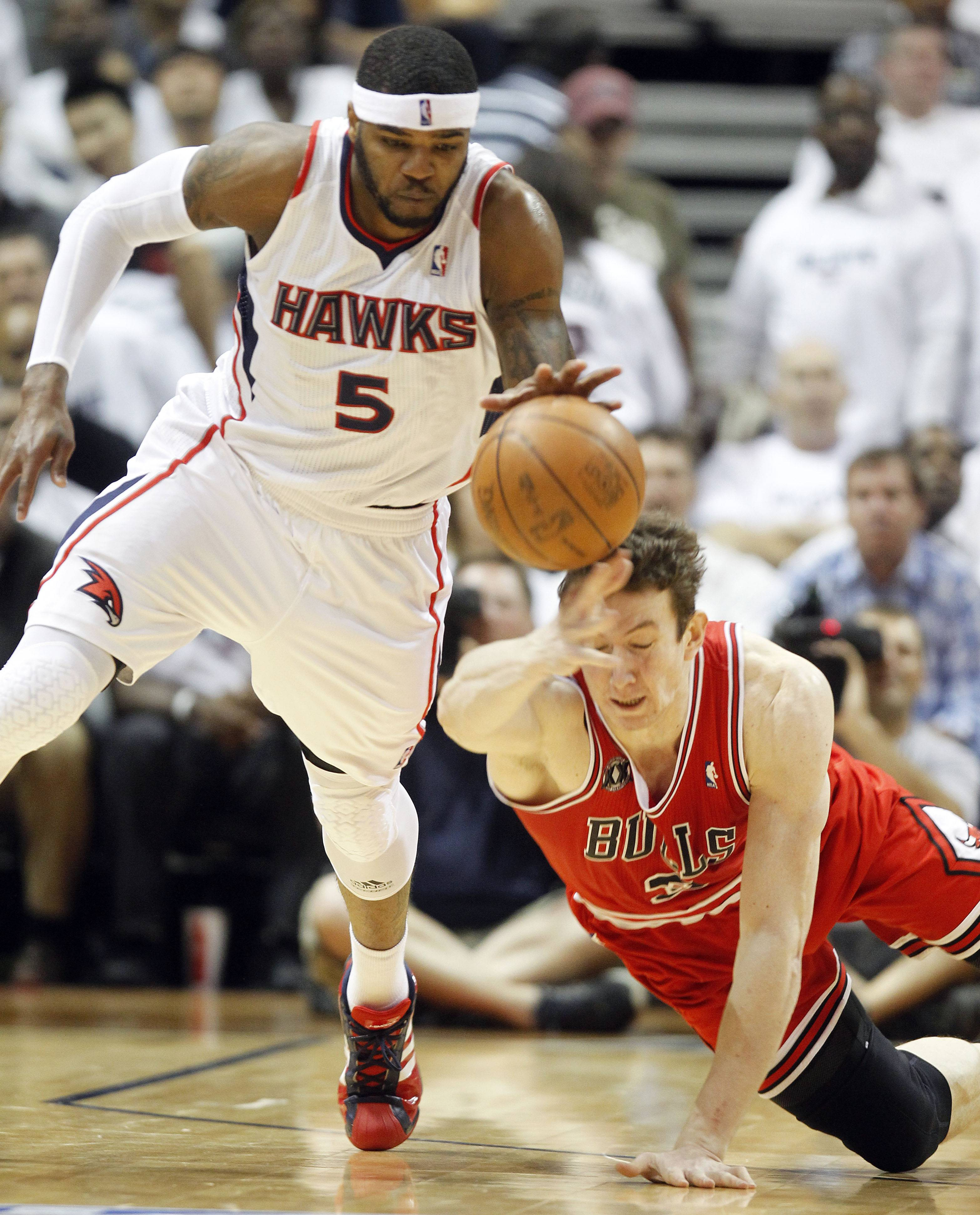 The Hawks' Josh Smith moves the ball up court as Bulls center Omer Asik falls to the court in the second quarter of Game 6 Thursday night.