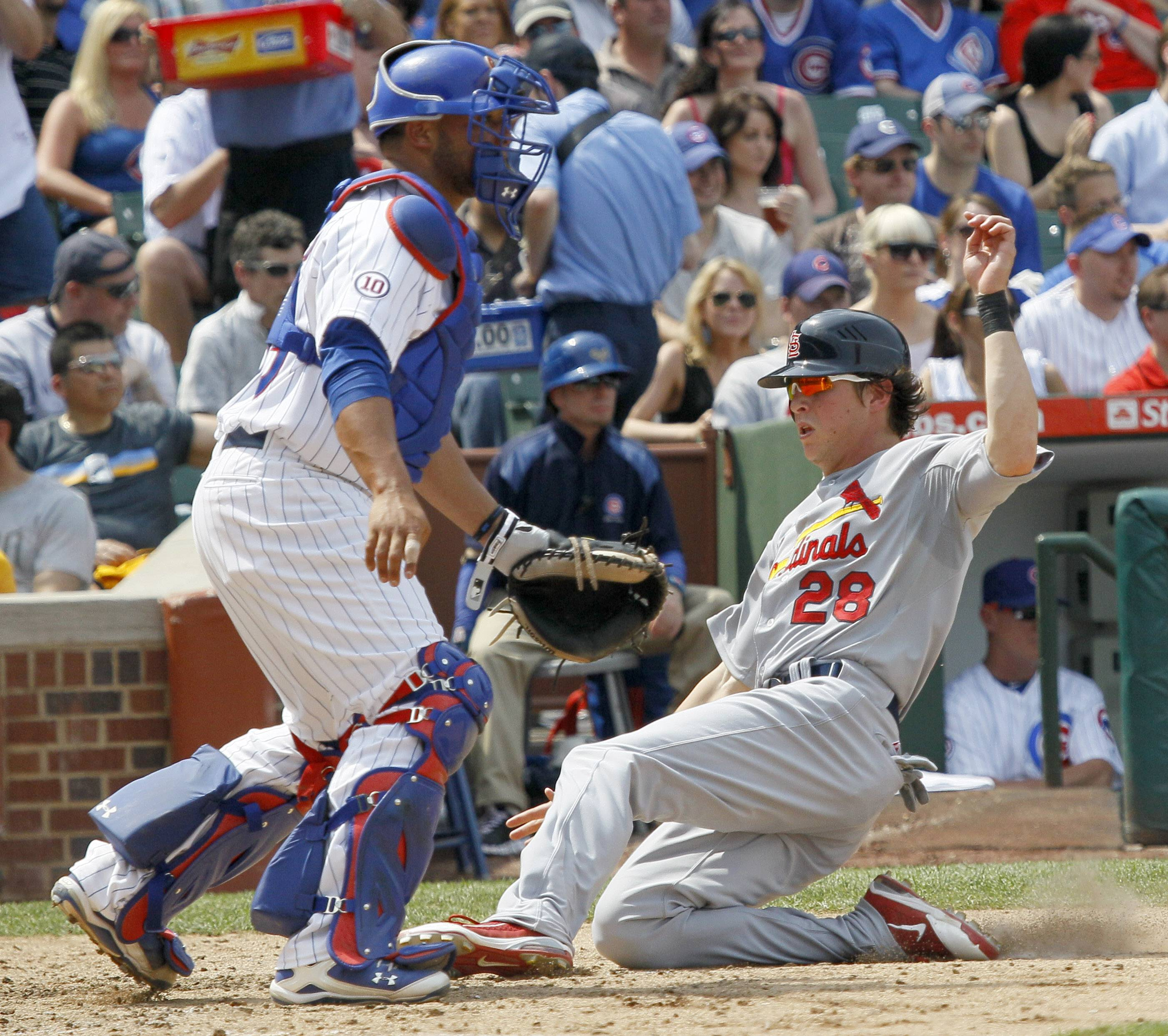 Colby Rasmus scores past Cubs catcher Welington Castillo off an RBI single by Yadier Molina during the fifth inning Thursday.