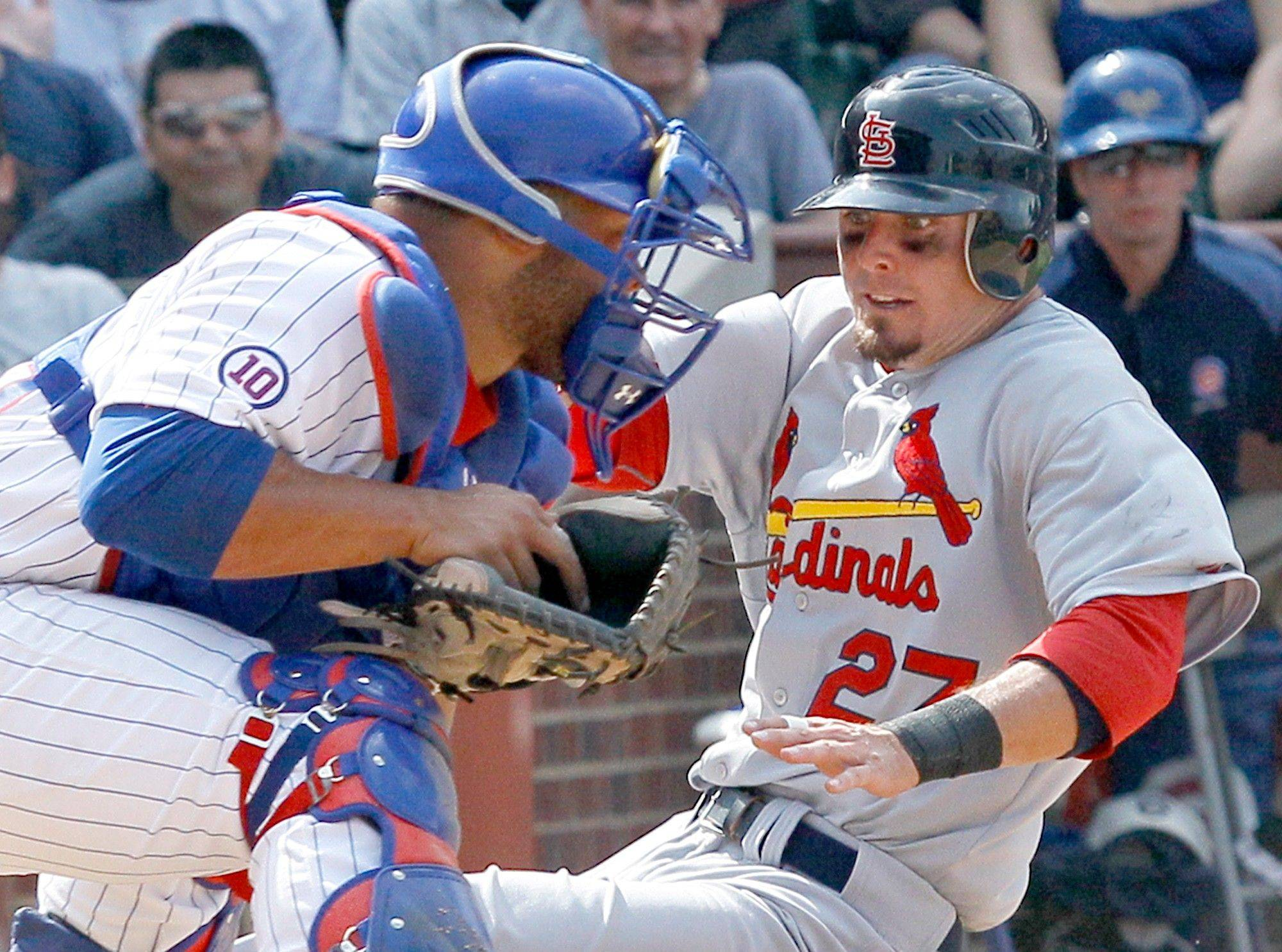 St. Louis Cardinals' Tyler Greene, right, slides safely behind Chicago Cubs catcher Welington Castillo off an RBI single by St. Louis Cardinals' Jon Jay and a throw from center fielder Marlon Byrd during the seventh inning of a baseball game Thursday, May 12, 2011 in Chicago.