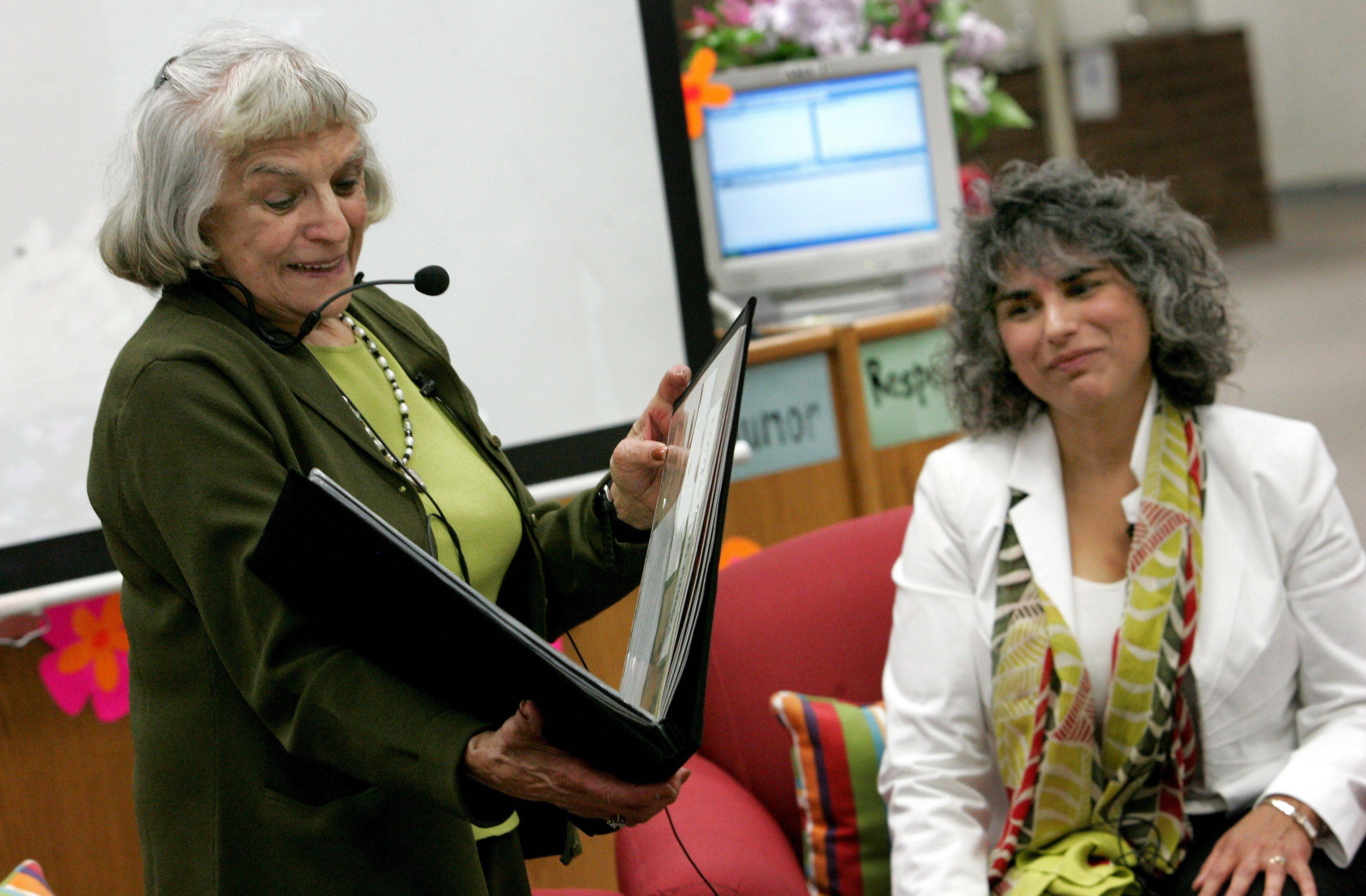 Madison Junior High School eighth-graders presented Edith Westerfeld and her daughter Fern Schumer Chapman with a scrapbook documenting the student's research efforts to track down Greda Katz.