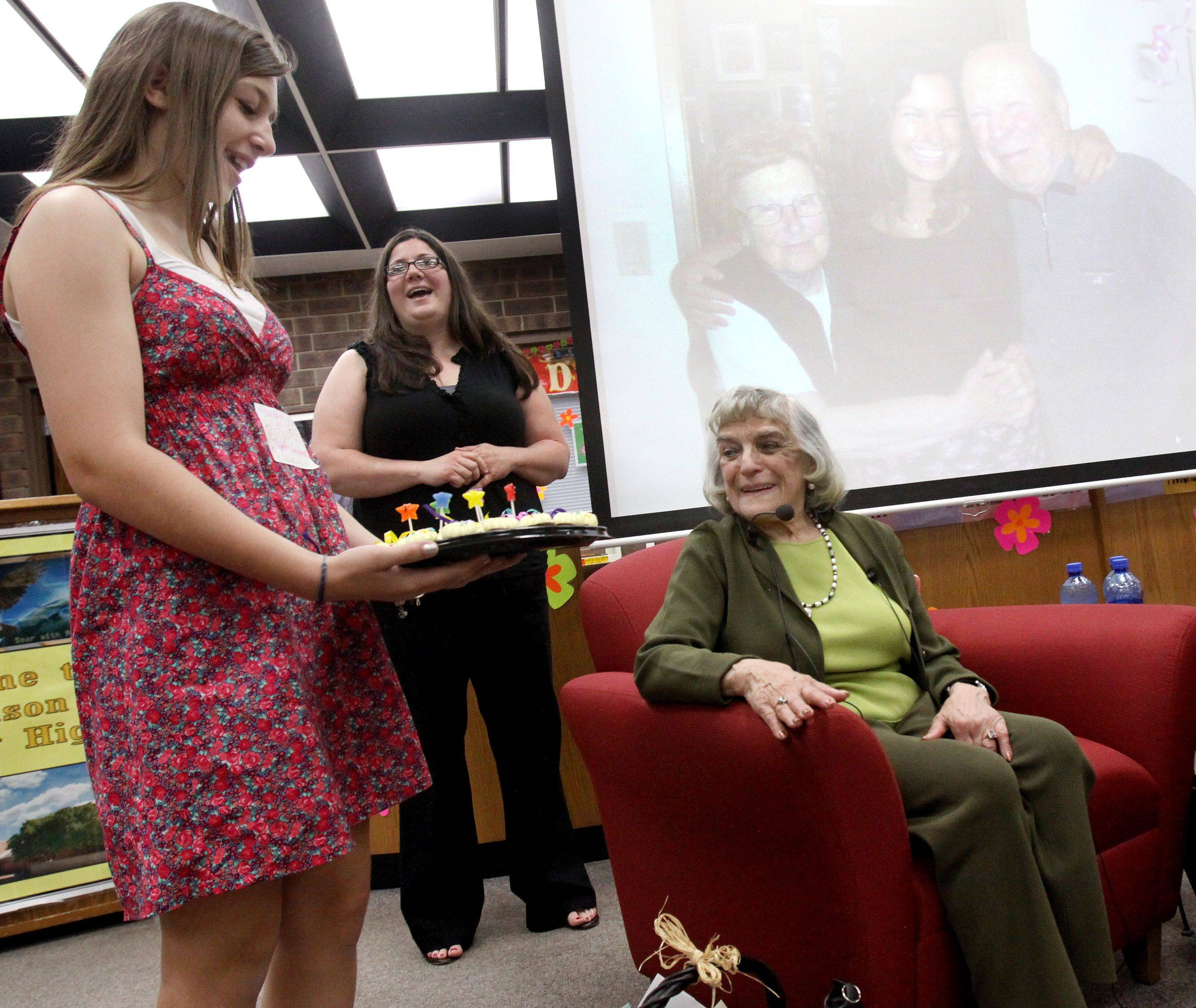 Edith Westerfeld is presented with surprise birthday cupcakes Friday during a reception held in her honor at Madison Junior High School in Naperville.