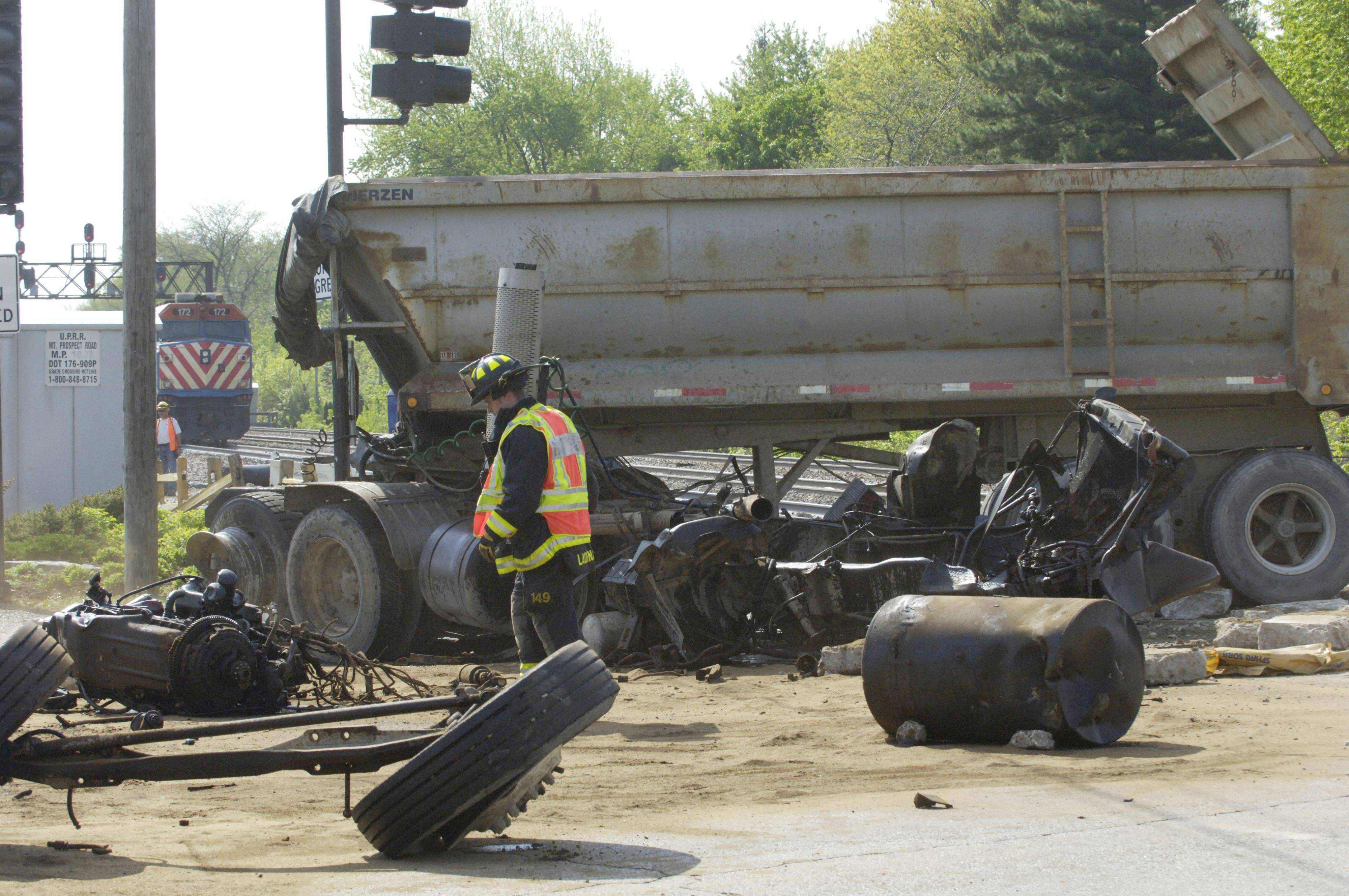 A Metra passenger train derailed after striking a loaded dump truck at Mount Prospect Road Friday morning.