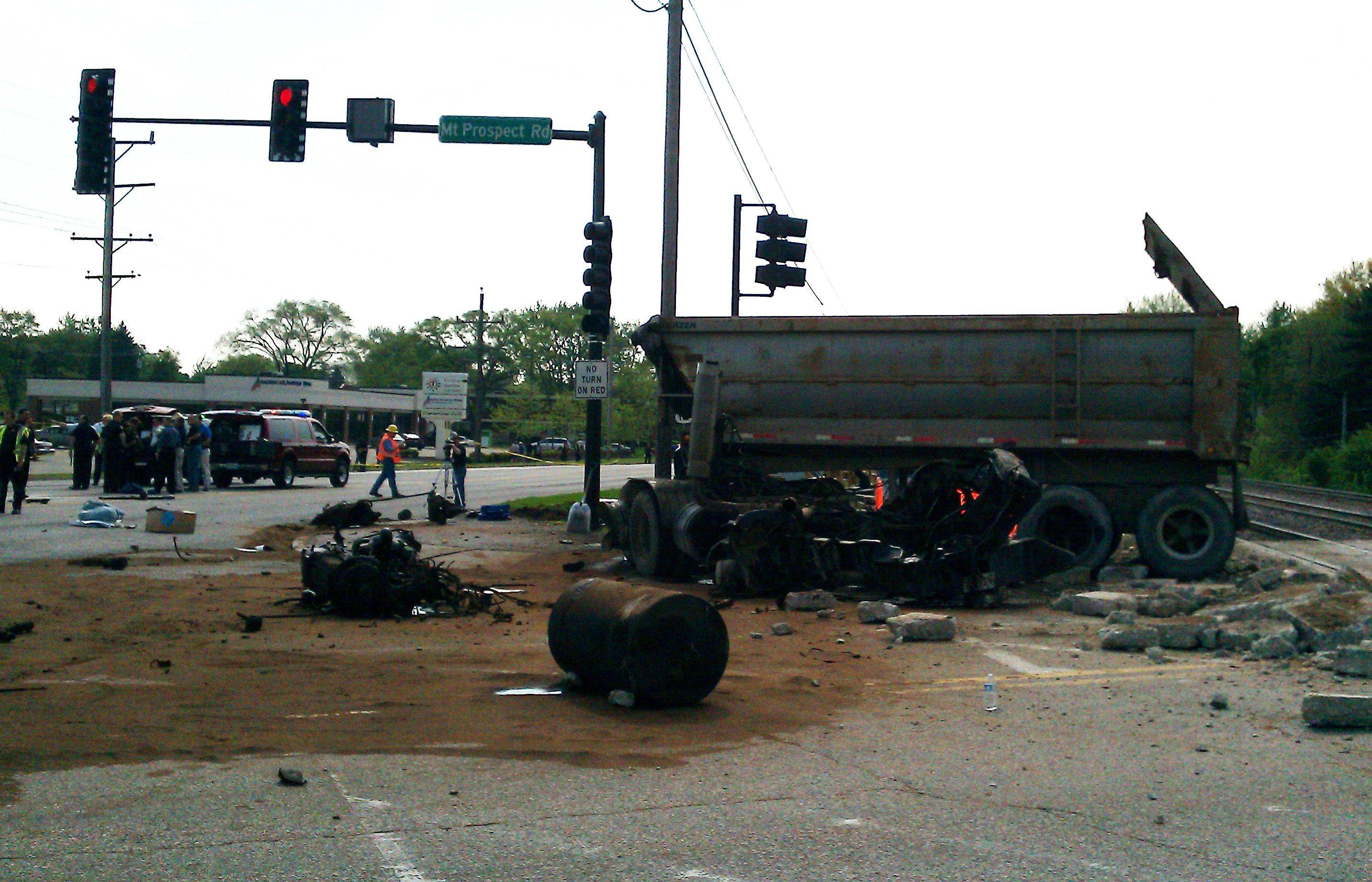Metra said all warnings were activated before a dump truck was driven in front of a train in Des Plaines on Friday.
