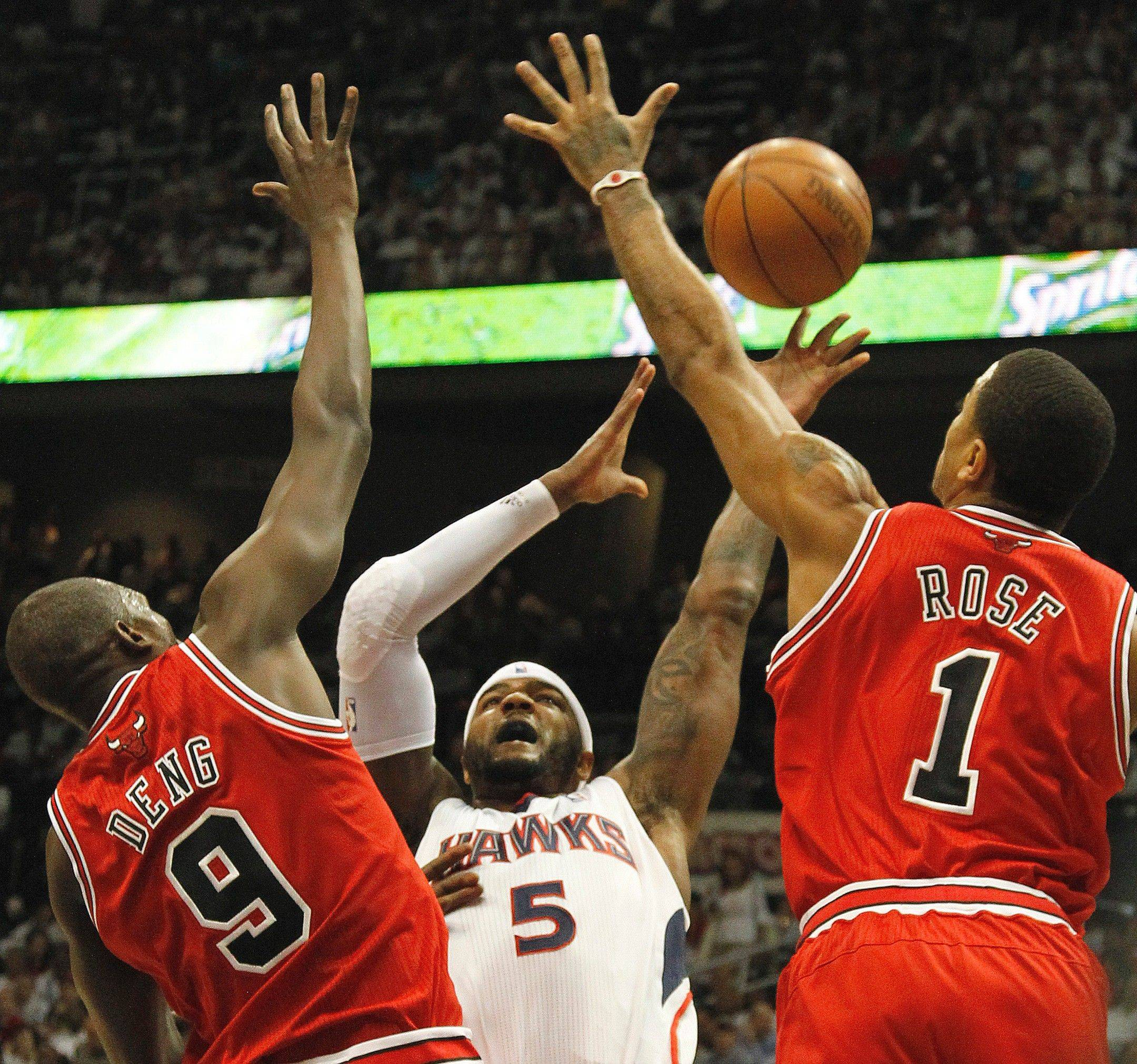 Chicago's Luol Deng and Derrick Rose defend against Atlanta's Josh Smith in the first quarter of Game 6 in Atlanta.