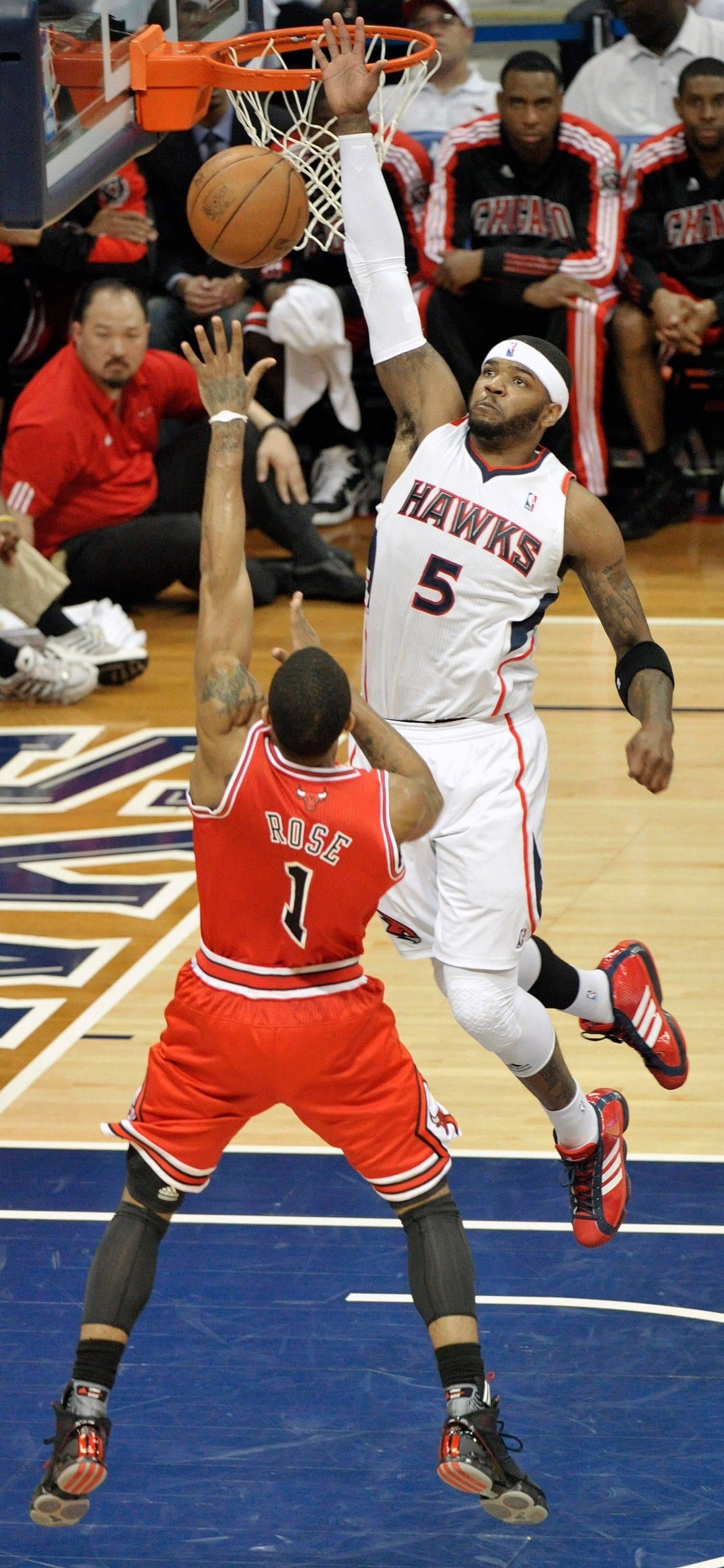 NBA MVP Derrick Rose shoots under the defense of Atlanta Hawks power forward Josh Smith in the second quarter of Game 6.