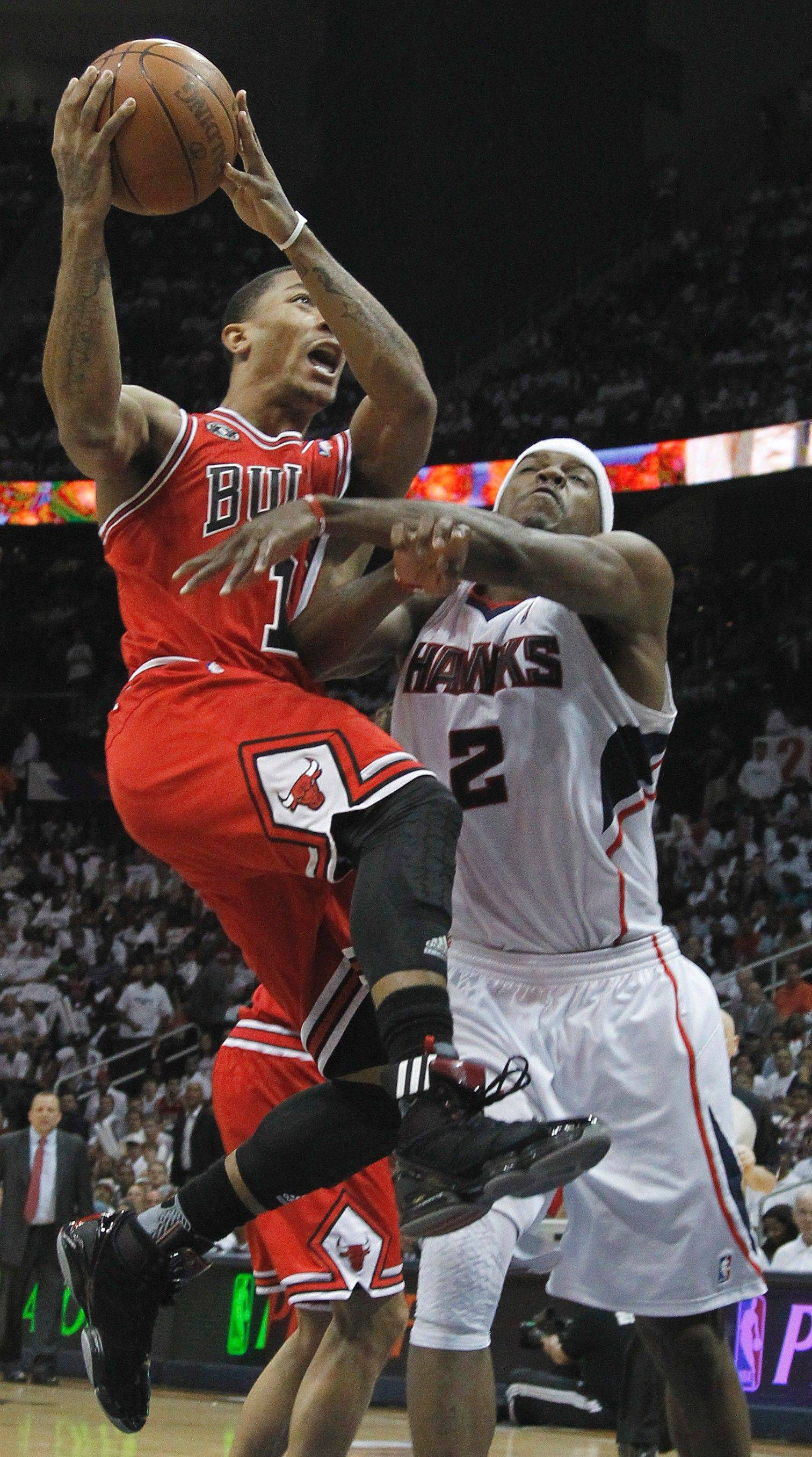 Derrick Rose goes to the basket as Hawks guard Joe Johnson defends Thursday.