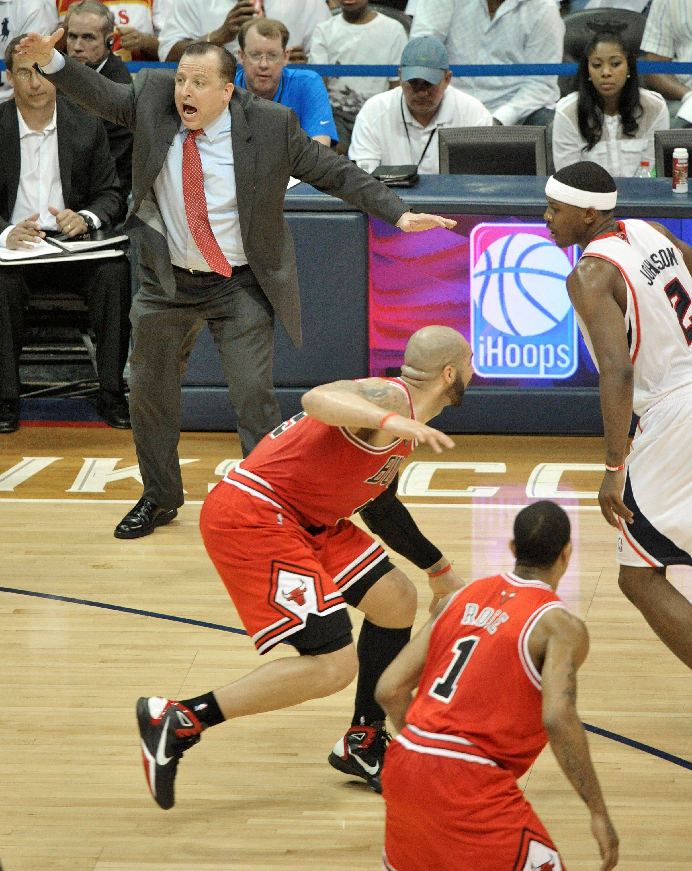 Chicago Bulls head coach Tom Thibodeau reacts to play as Atlanta's Joe Johnson moves the ball up court and Chicago's Carlos Boozer and Derrick Rose defend in the third quarter of Game 6.