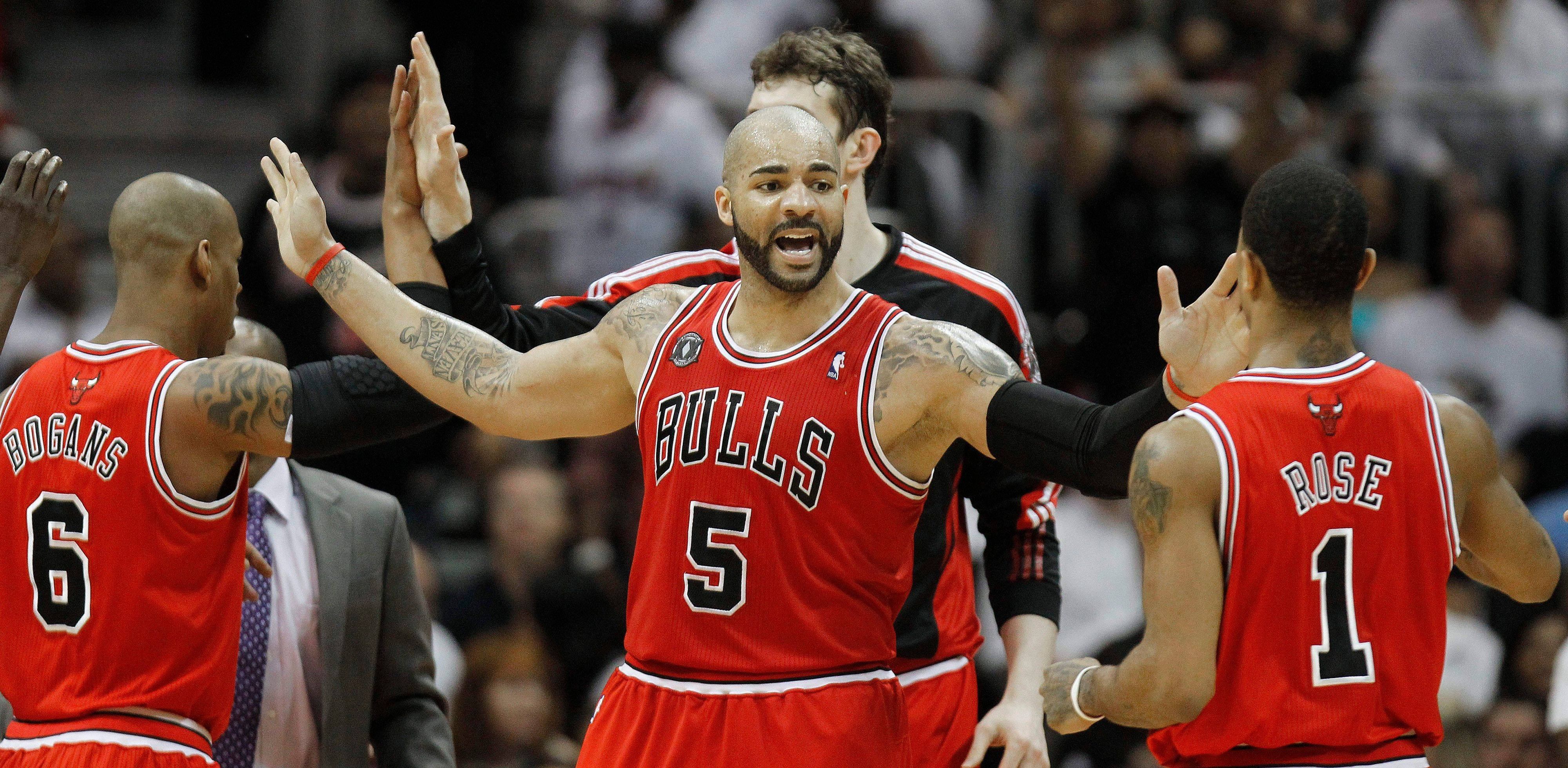 Carlos Boozer reacts to a goal with teammates Keith Bogans and Derrick Rose in the third quarter of Game 6 of the NBA Eastern Conference semifinals.