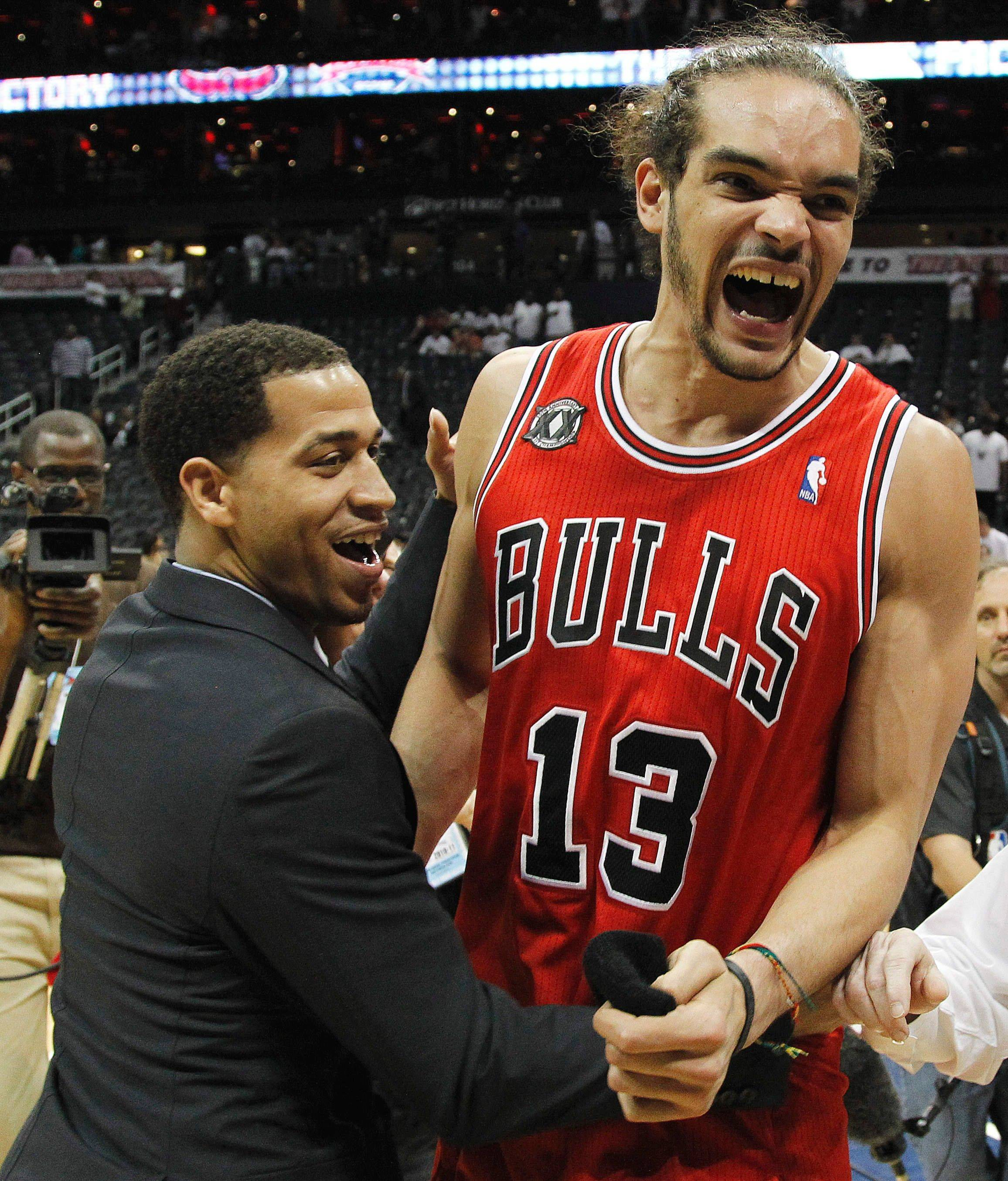 Joakim Noah and teammate Jannero Pargo react to the teams win against the the Atlanta Hawks.