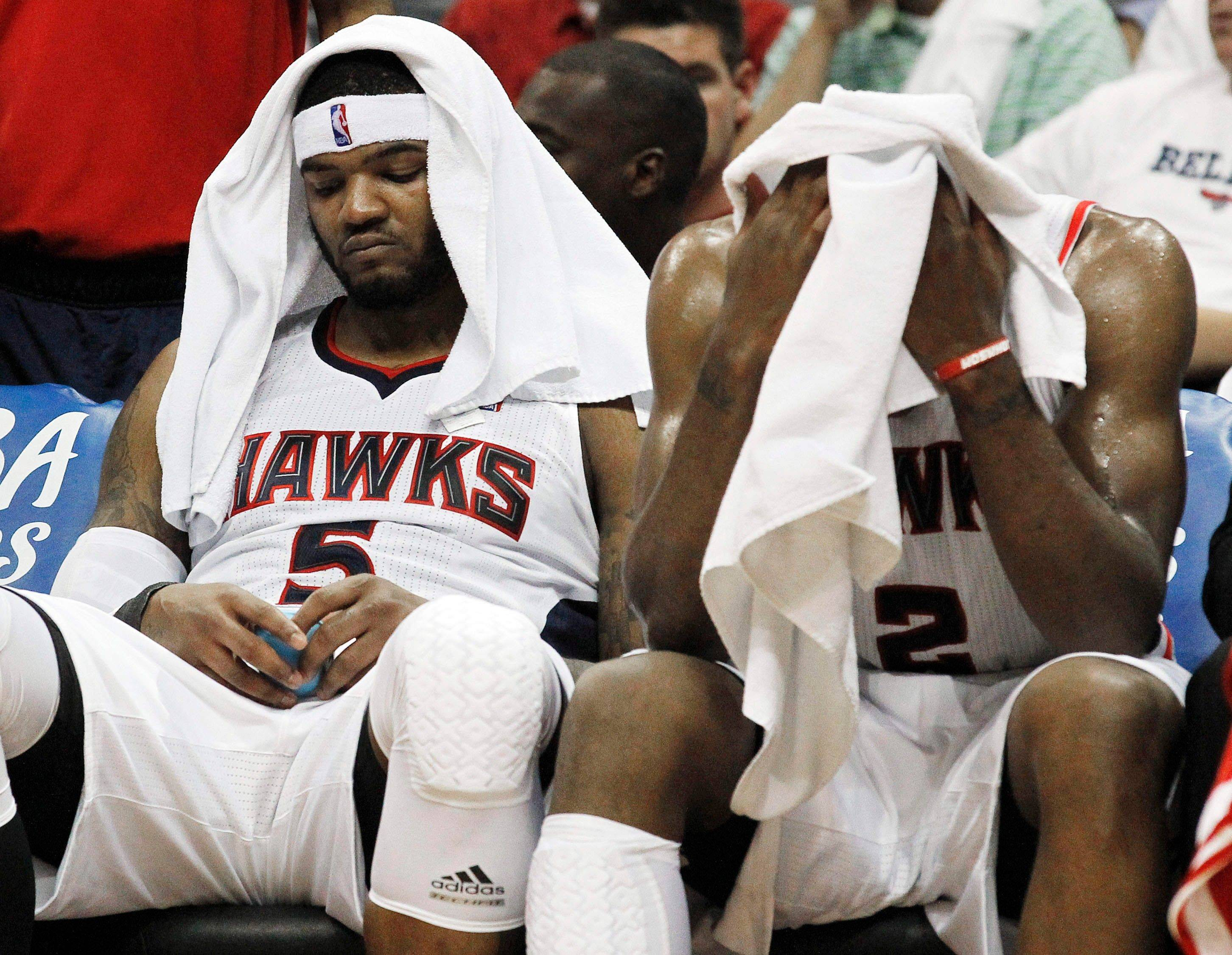 Atlanta Hawks forward Josh Smith and teammate Joe Johnson, right, react in the closing seconds of the fourth quarter of Game 6 Thursday. Chicago won 93-73 to advance to the Eastern Conference Finals against the Miami Heat.