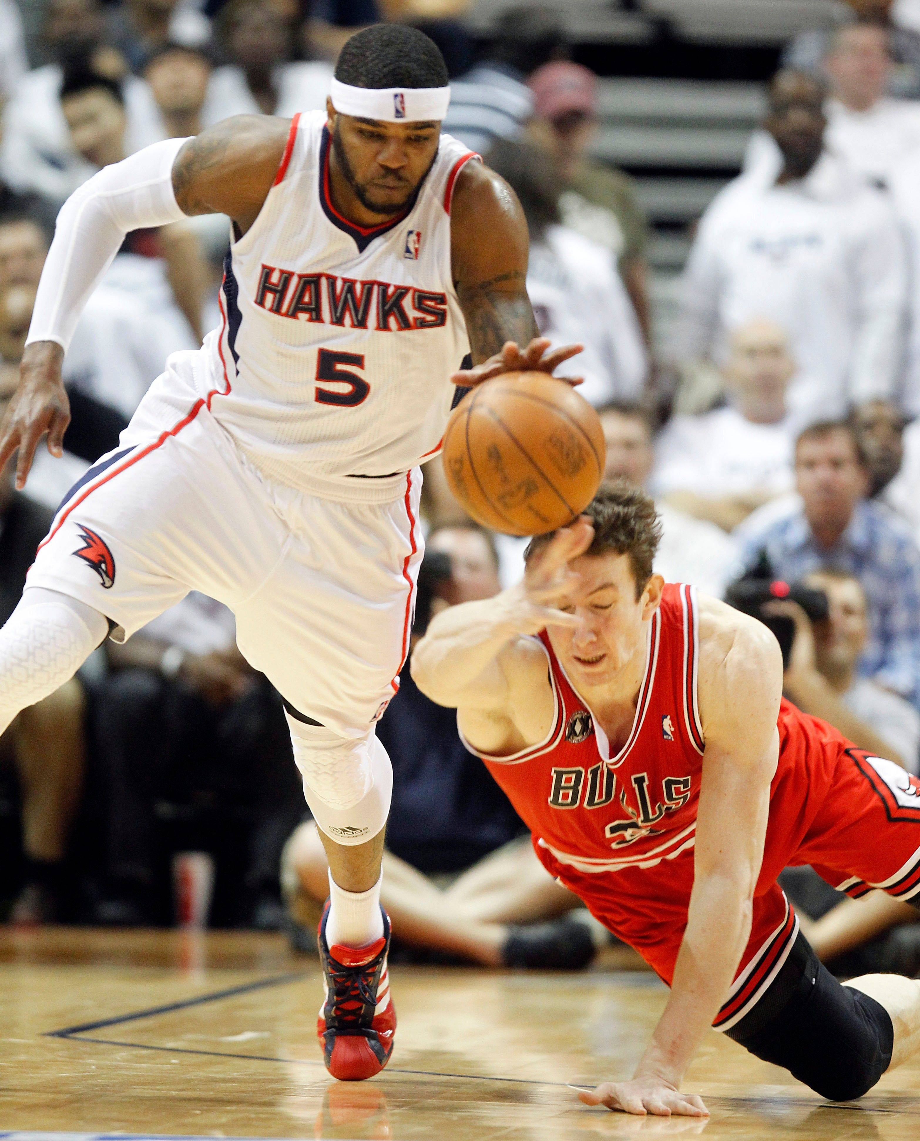 Hawks forward Josh Smith moves the ball up court as Bulls center Omer Asik falls to the court in the second quarter of Game 6 in Atlanta.