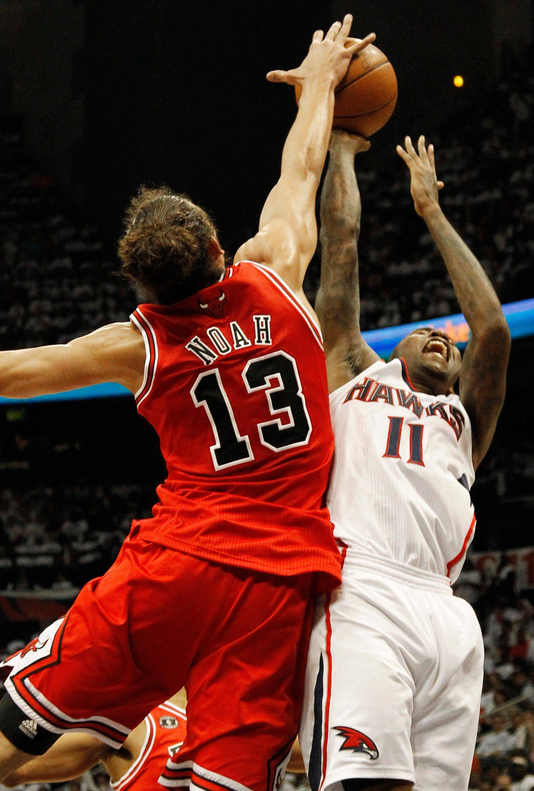 Atlanta Hawks guard Jamal Crawford and Chicago Bulls center Joakim Noah vie for a loose ball in the first quarter of Game 6.