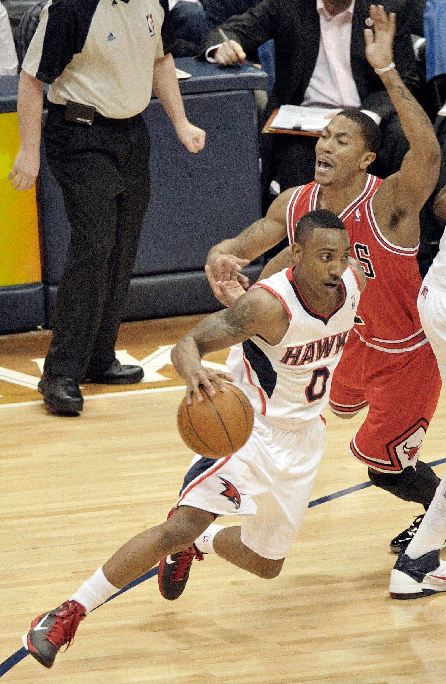 Chicago Bulls point guard Derrick Rose defends Atlanta Hawks guard Jeff Teague in the first quarter of Game 6 in Atlanta Thursday.
