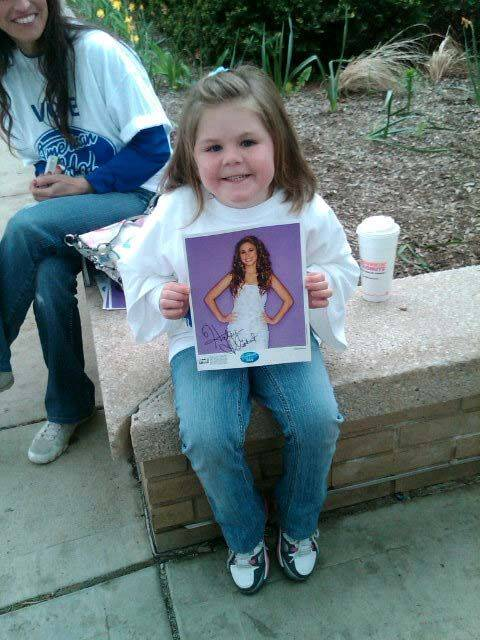 Abriella Wolff, 5 waits to get a glimpse of Haley Reinhart photo during a visit to Wheeling High School Saturday.