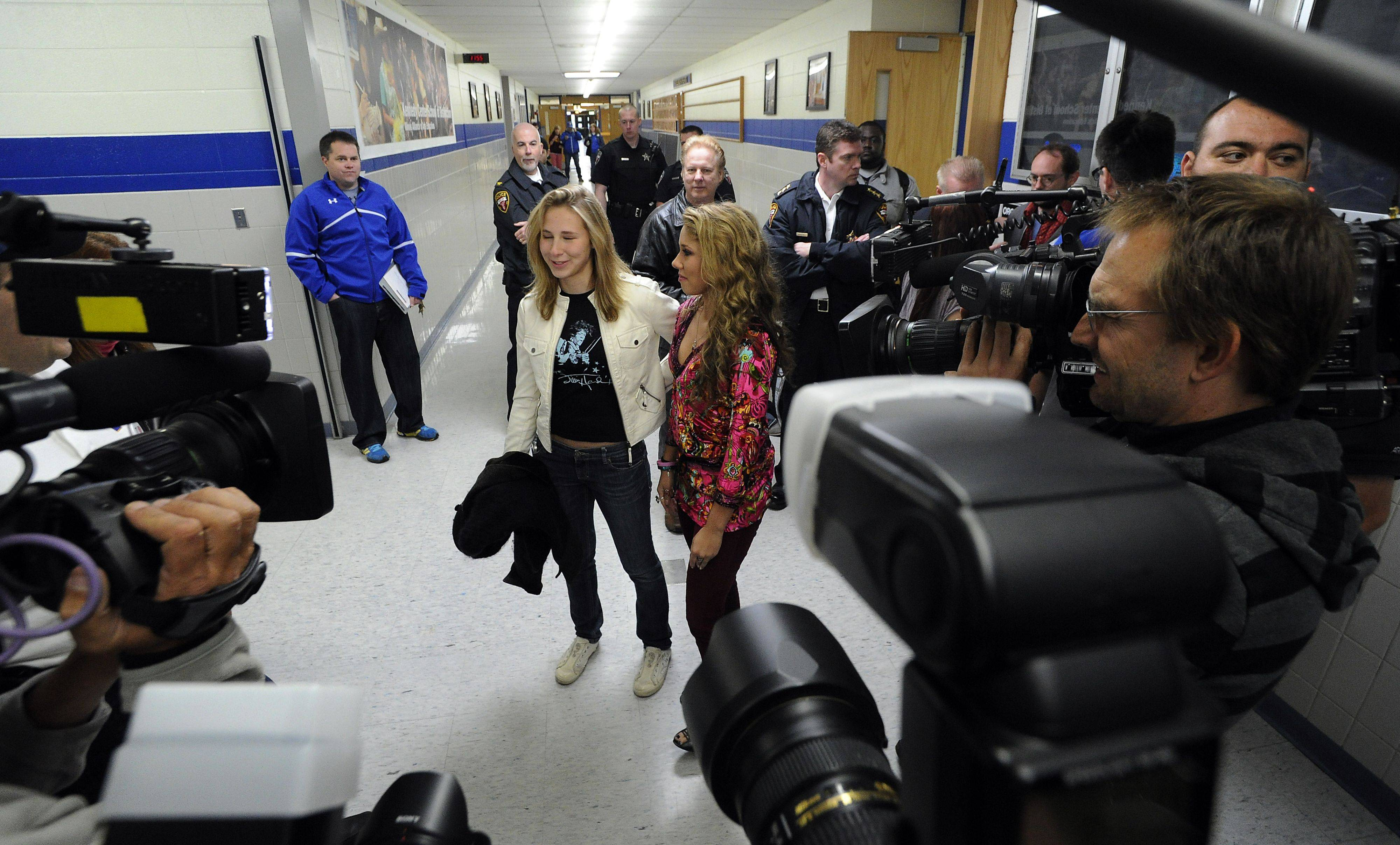 Haley Reinhart greets her fans at the Wheeling High School on Saturday as part of her American Idol hometown tour with her sister Angelia.