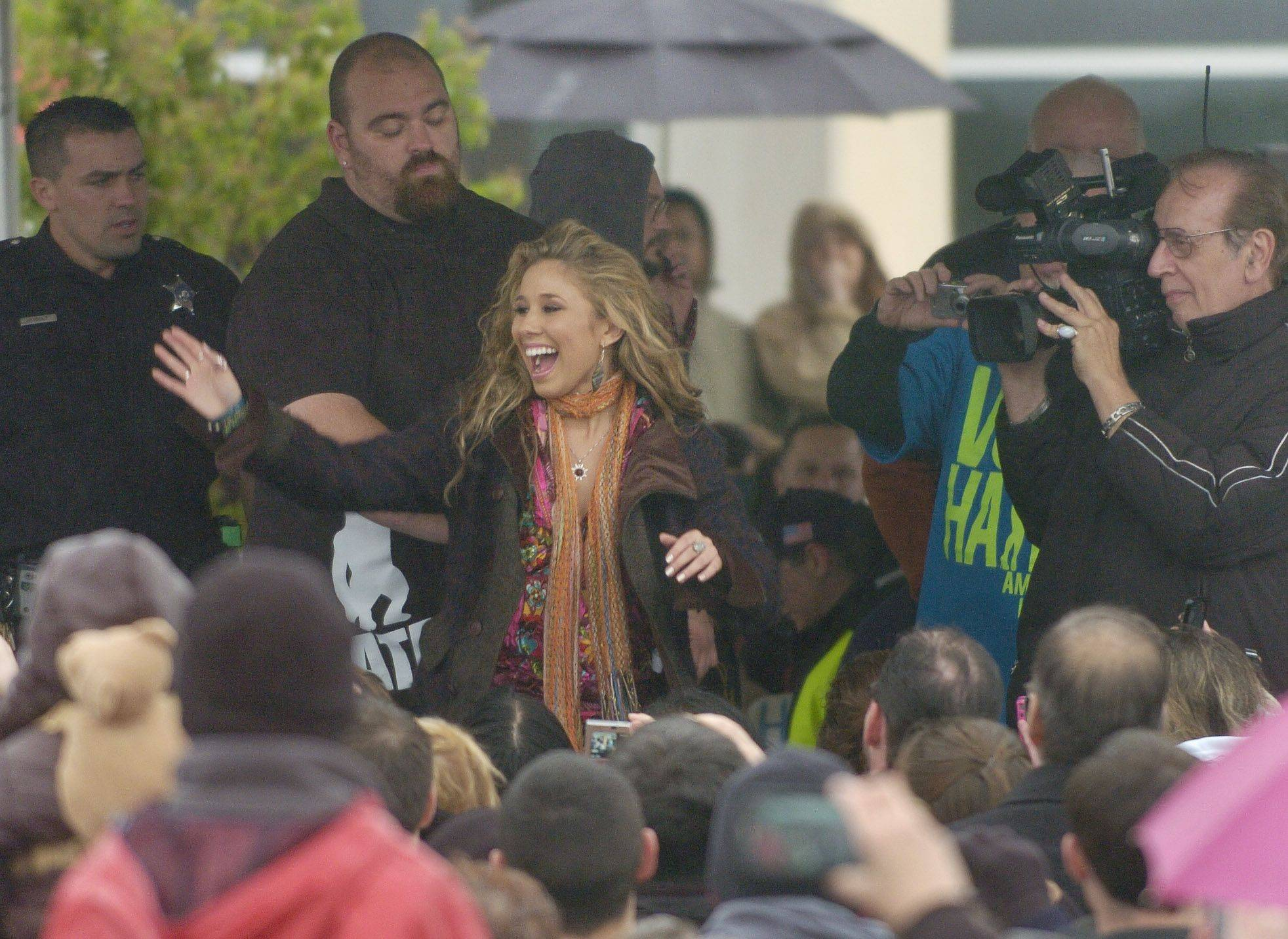 American Idol finalist Haley Reinhart greets fans during a gathering at the Wheeling Village Hall Saturday.