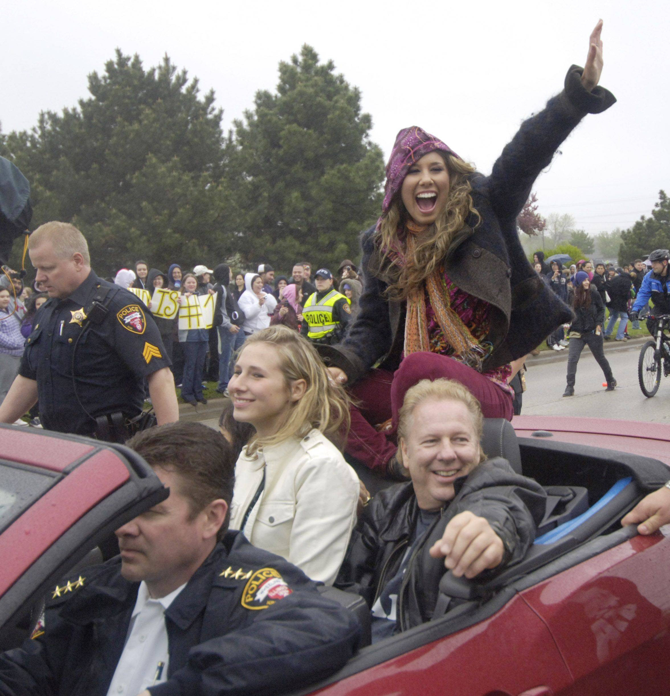 American Idol finalist Haley Reinhart is welcomed home to Wheeling with a parade on Dundee Road Saturday.