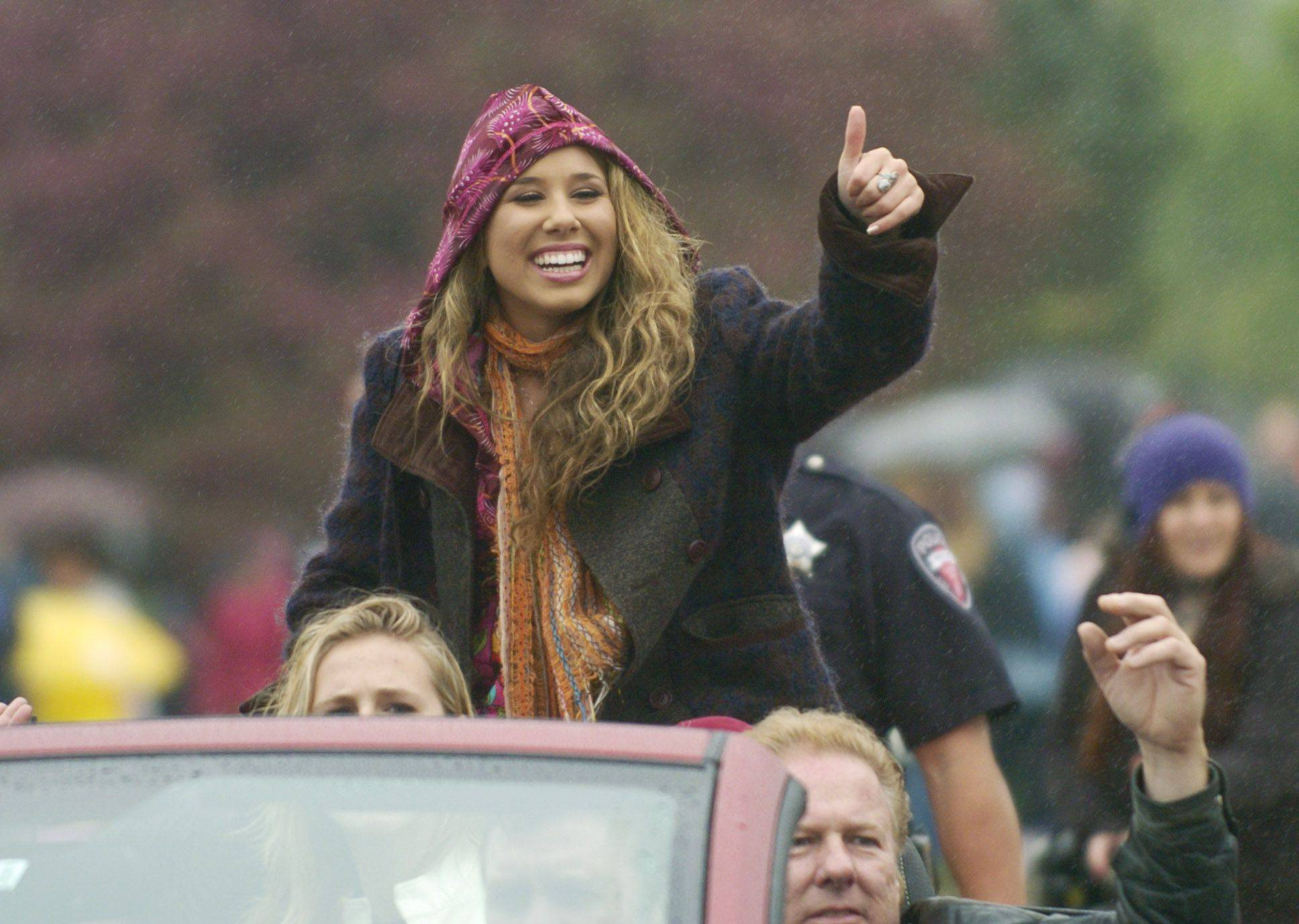 American Idol finalist Haley Reinhart gives a thumbs up as she is welcomed home to Wheeling with a parade along Dundee Road Saturday.
