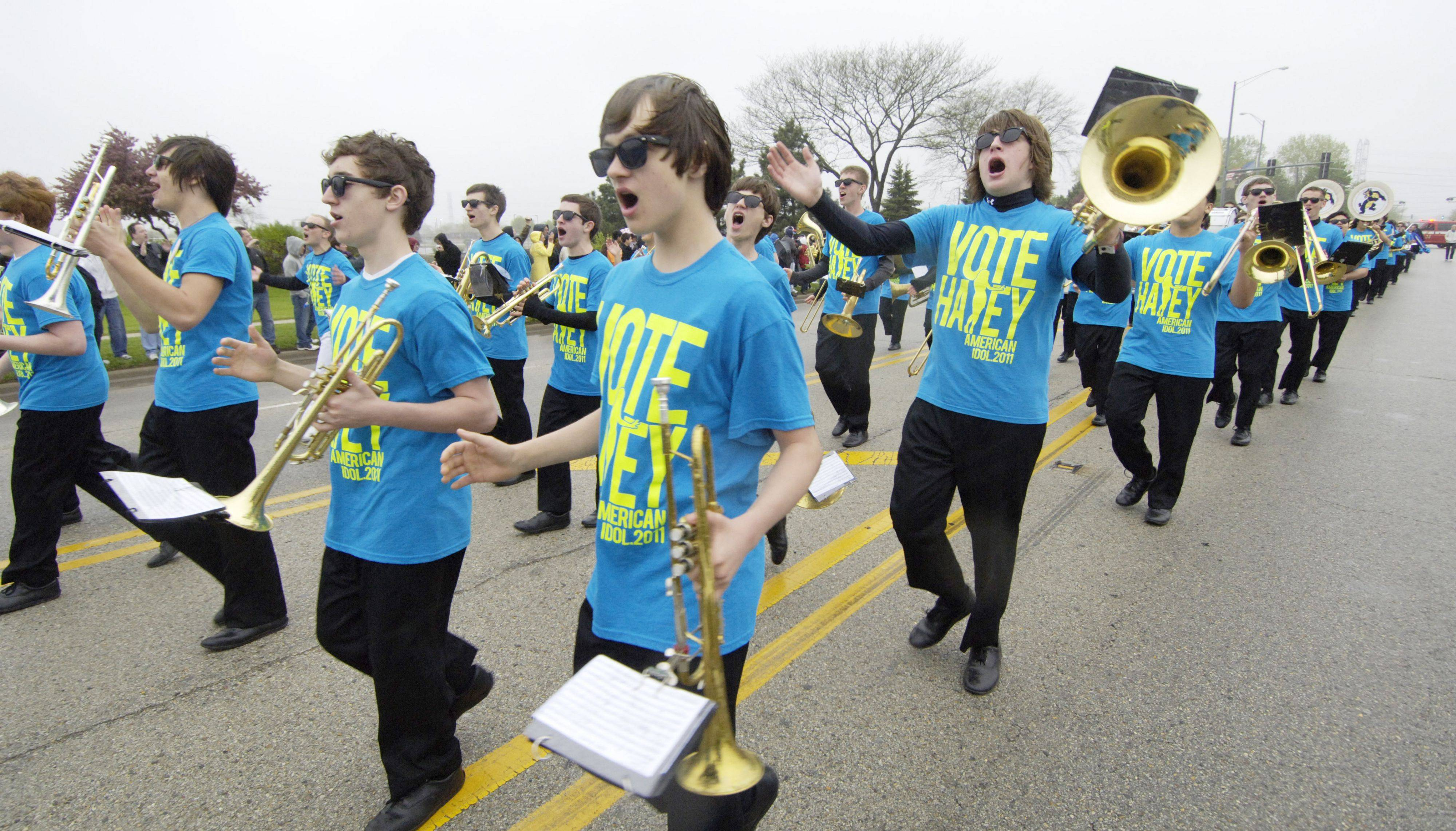 The Wheeling High School band lead the way as American Idol finalist Haley Reinhart is welcomed home to Wheeling with a parade Saturday.
