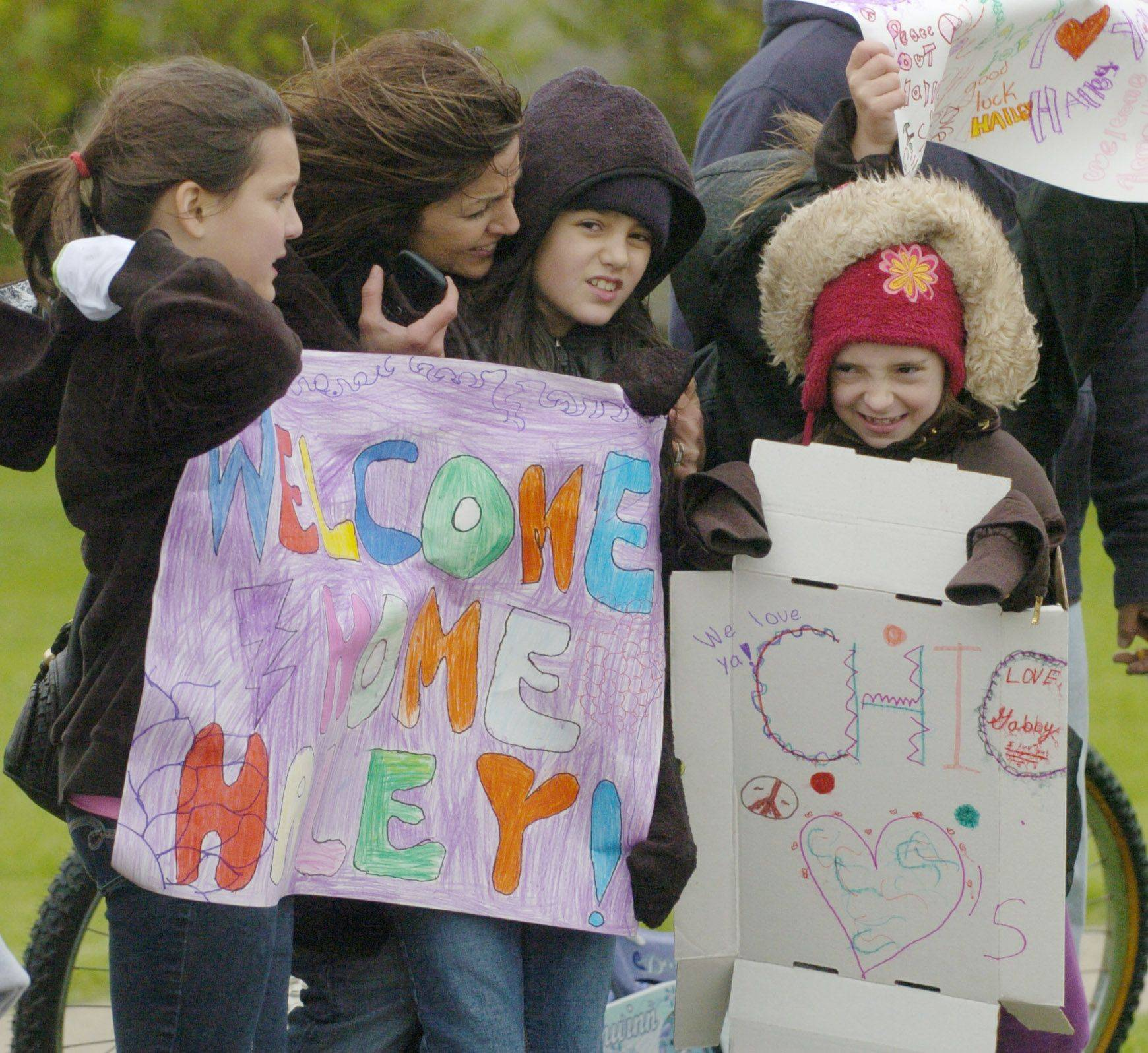 Fans along the parade route endure wind and rain as American Idol finalist Haley Reinhart is welcomed home to Wheeling Saturday.