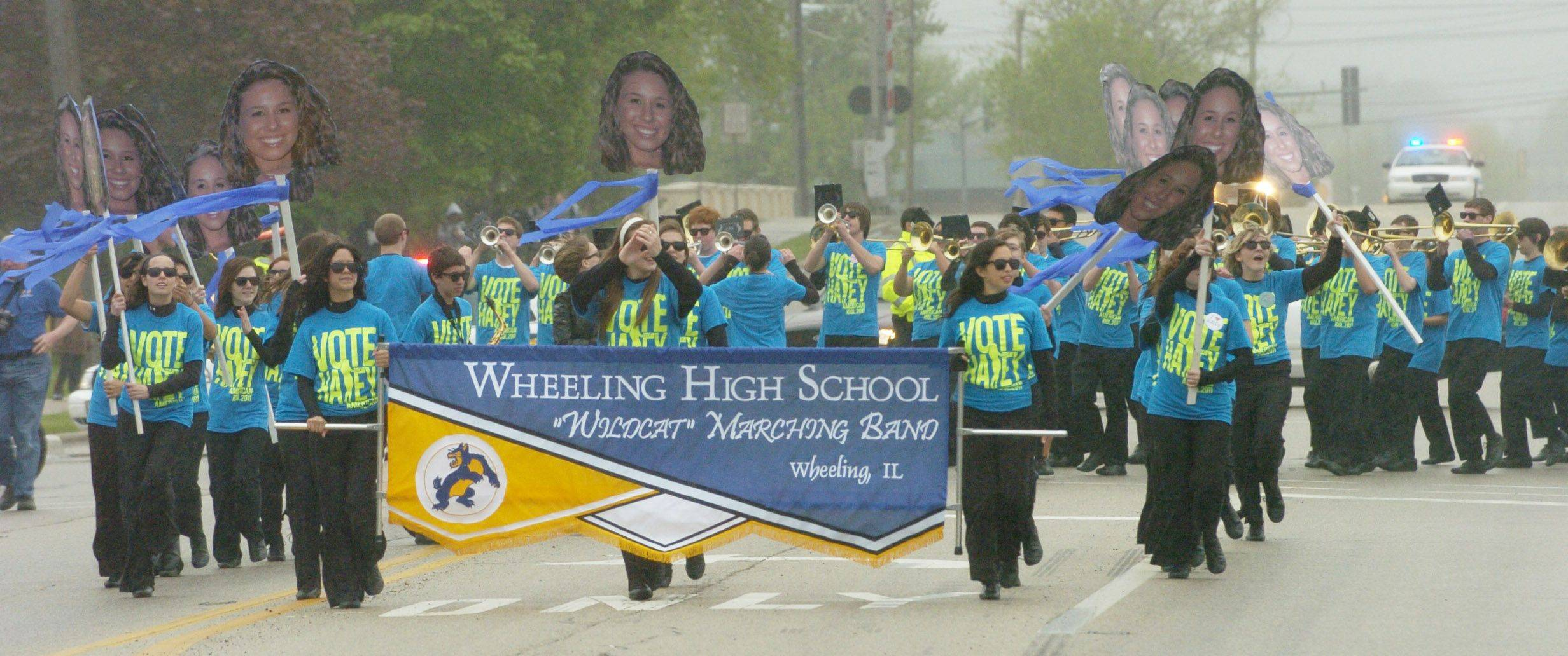 The Wheeling High School Marching Band leads the way with a parade along Dundee Road as American Idol finalist Haley Reinhart is welcomed home to Wheeling Saturday.