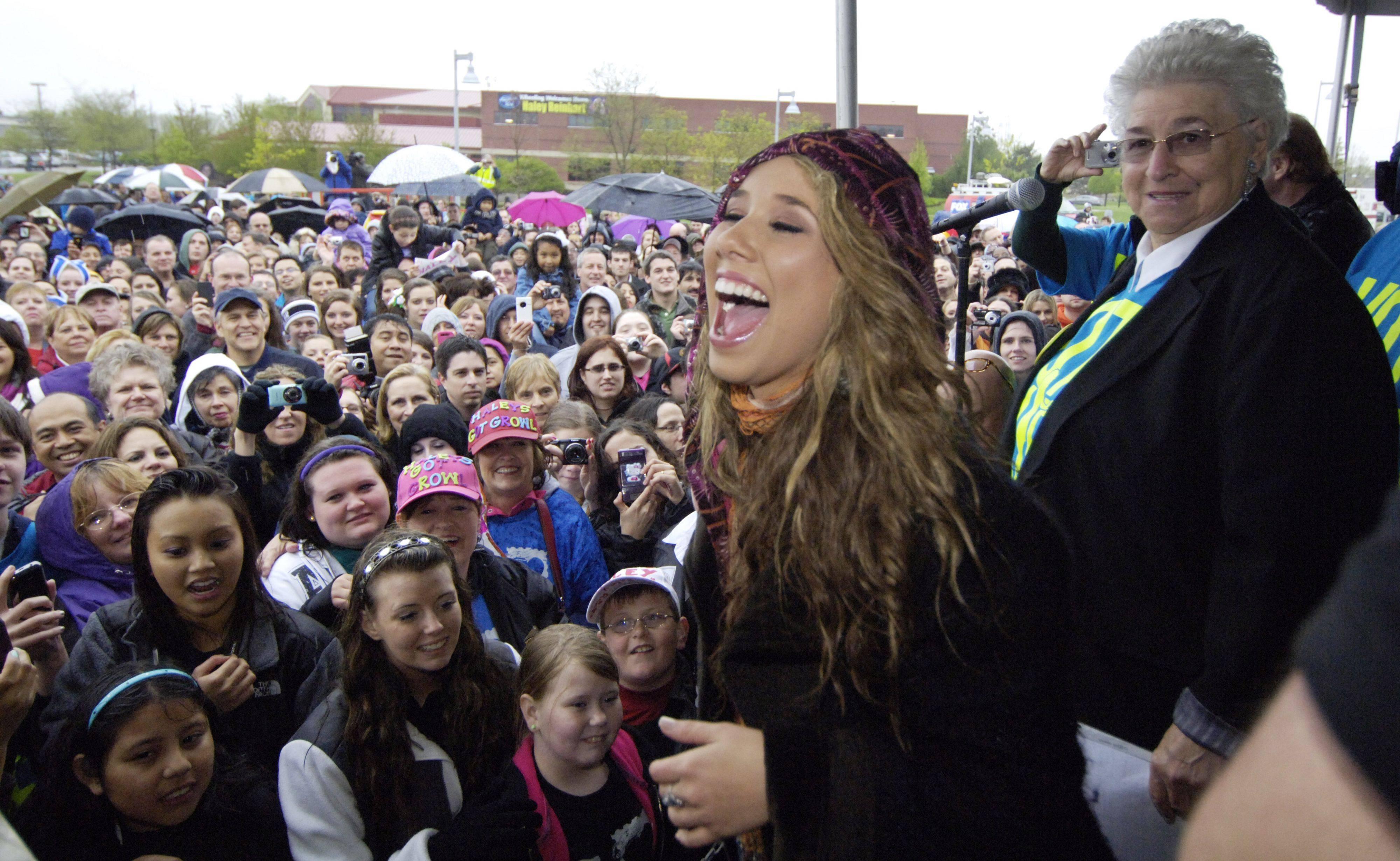 American Idol finalist Haley Reinhart is welcomed home to Wheeling by Mayor Judy Abruscato during a gathering near the village hall Saturday.