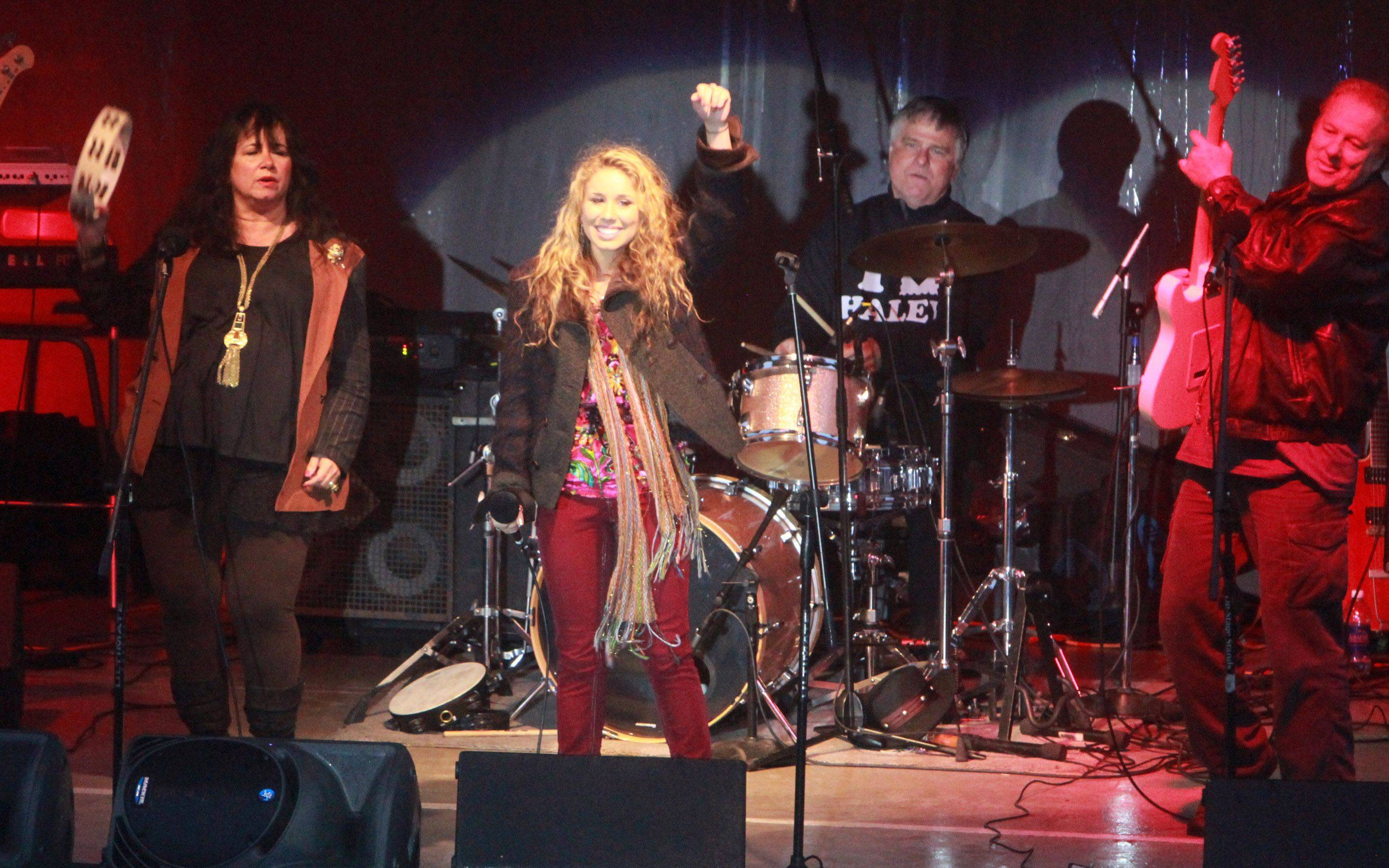 American Idol finalist Haley Reinhart sings with her parents Pattie and Harry's band Midnight at Arlington Park on Saturday.