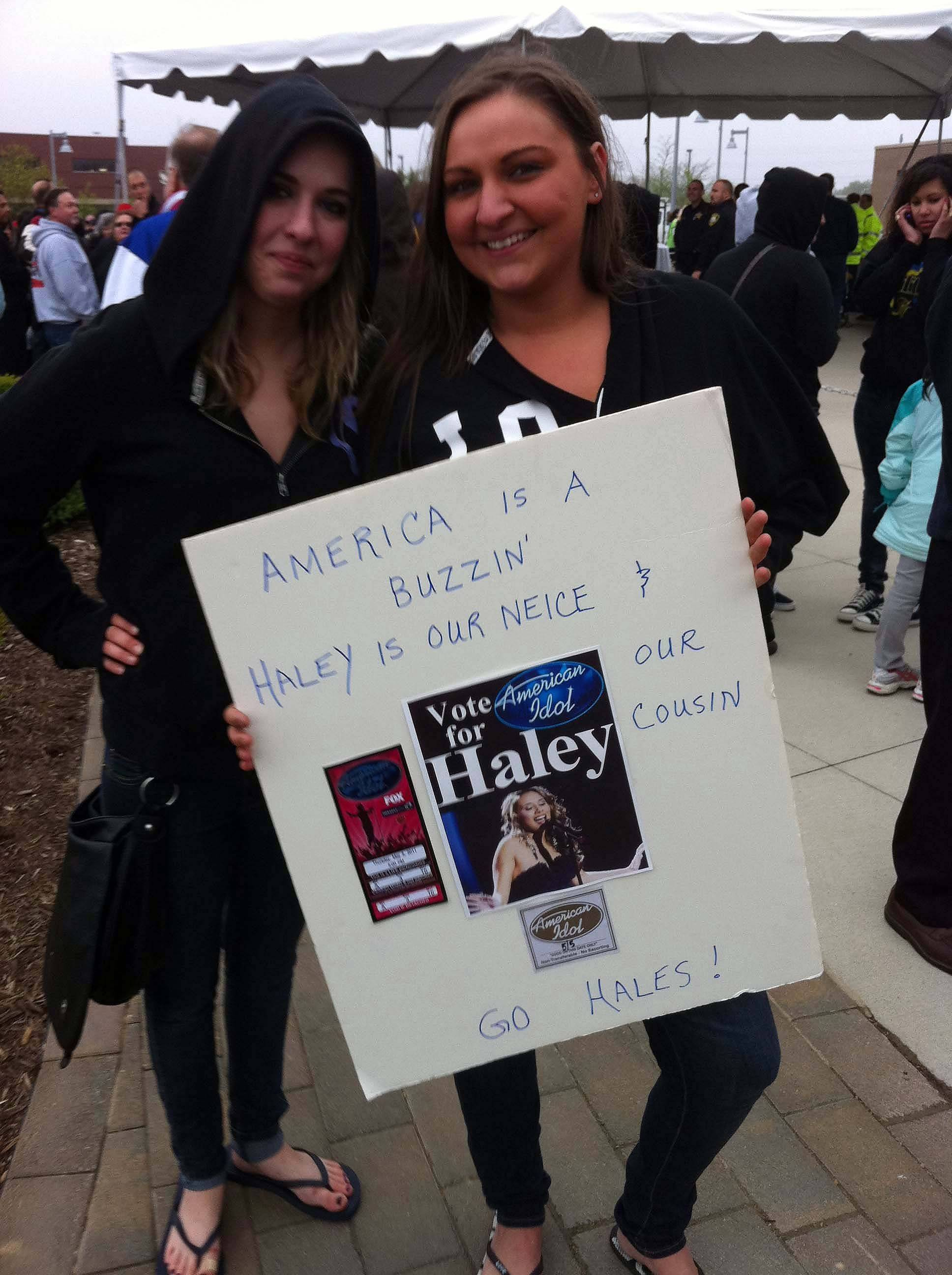 "Emma and Molly Rosenfield, cousins of Haley Reinhart brought their homemade sign out to cheer on their cousin at Wheeling's village hall Saturday. It featured a laminated ticket from when the girls flew to Los Angeles to see Haley perform, which was the week she covered Blondie's ""Call Me."""