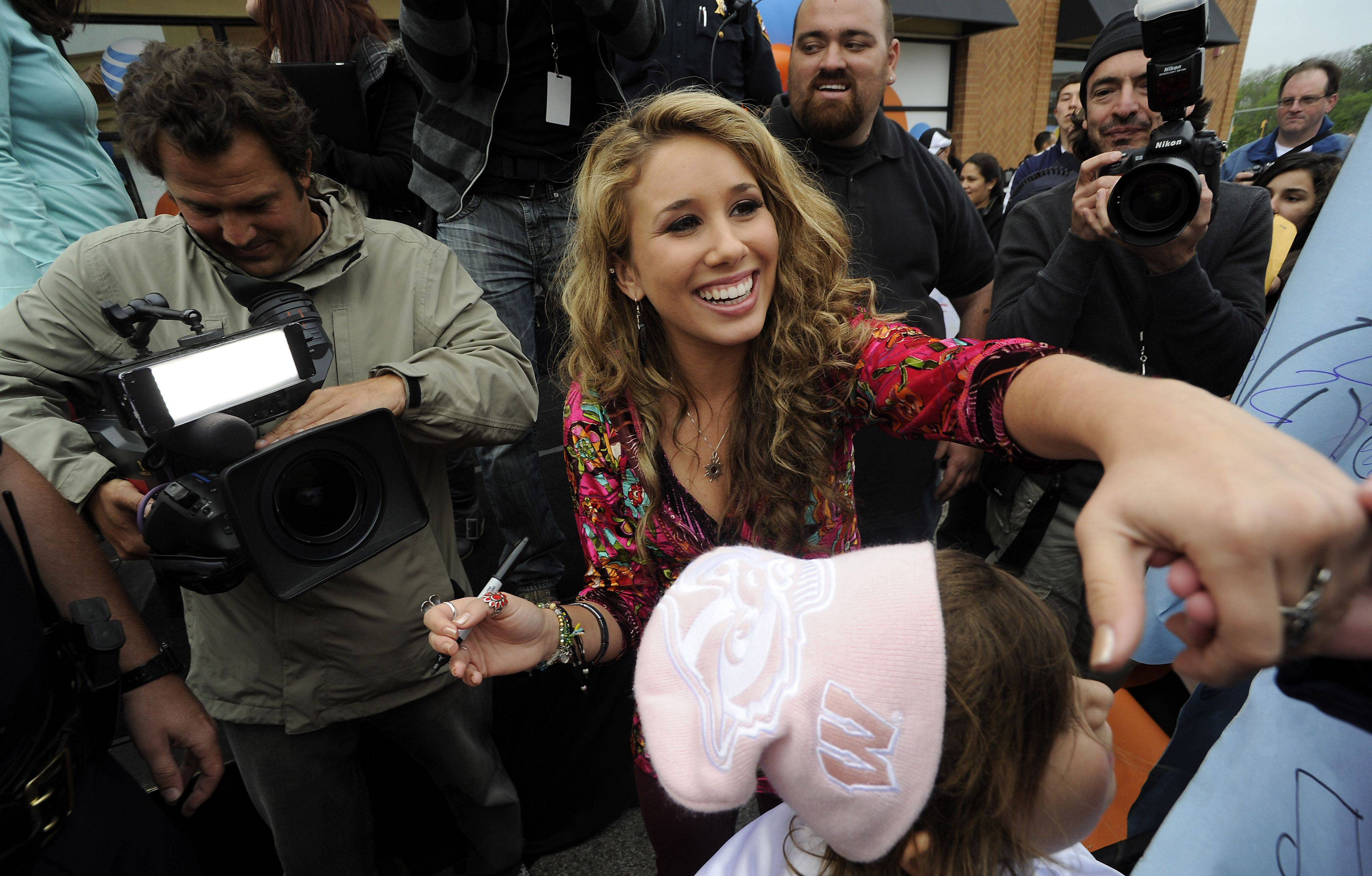 "Haley Reinhart greets her fans at the AT&T store in Deer Park on Saturday as part of her ""American"" Idol hometown tour."