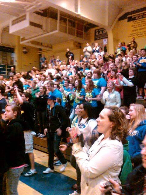 Fans at Wheeling High School applaud for Haley during a visit to her former school Saturday.