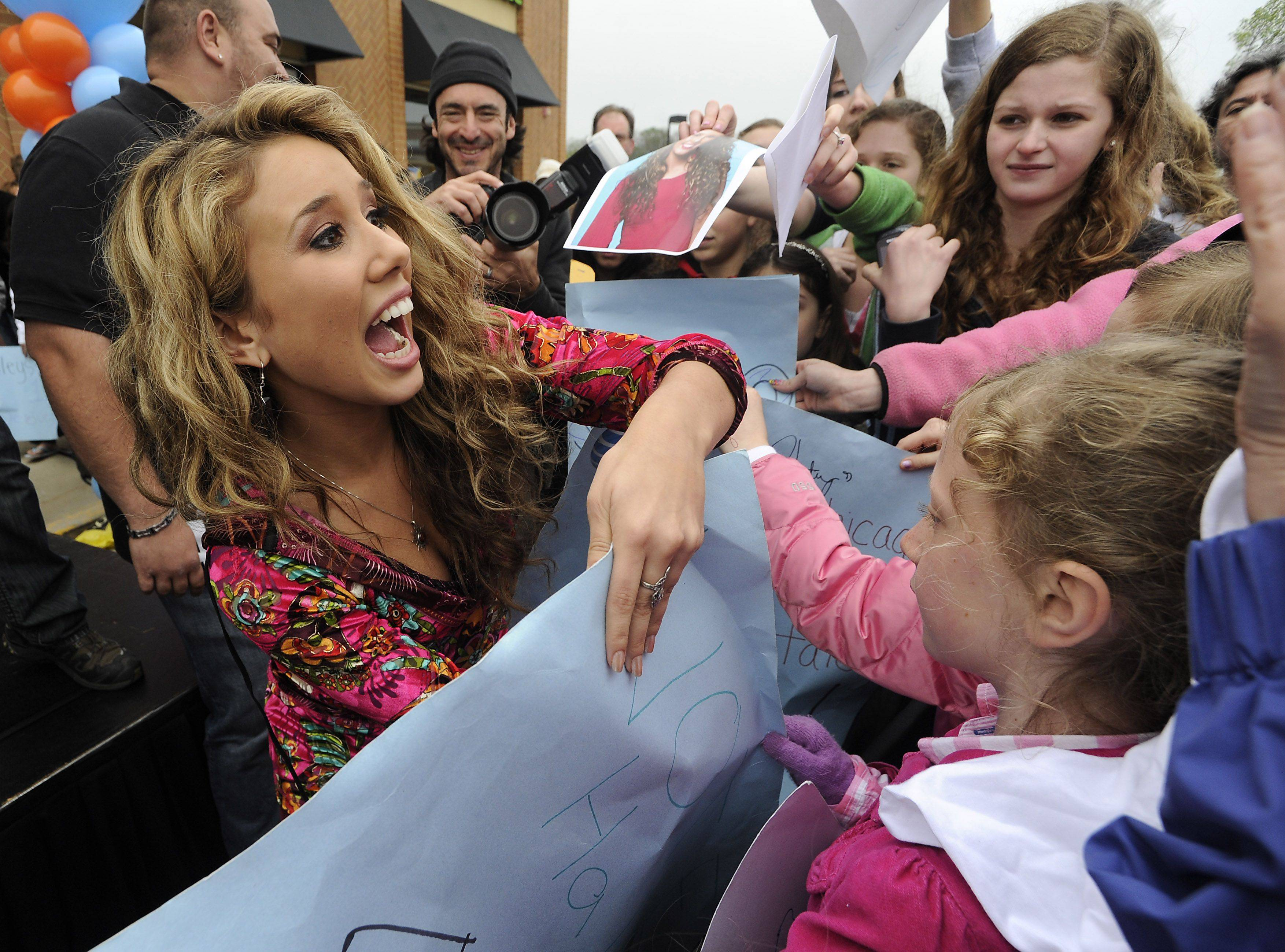 "Haley Reinhart greets her fans at the AT&T store in Deer Park Saturday as part of her hometown ""American Idol"" tour."