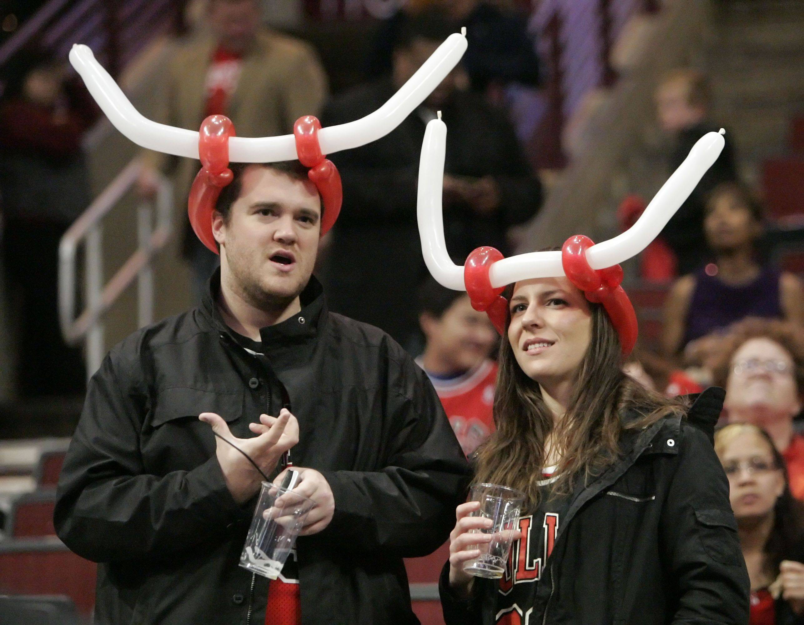 Drew and Chrissy Flintosh of Miami, Florida donned Bulls balloon hats as they hang out before game one of the Eastern Conference finals.