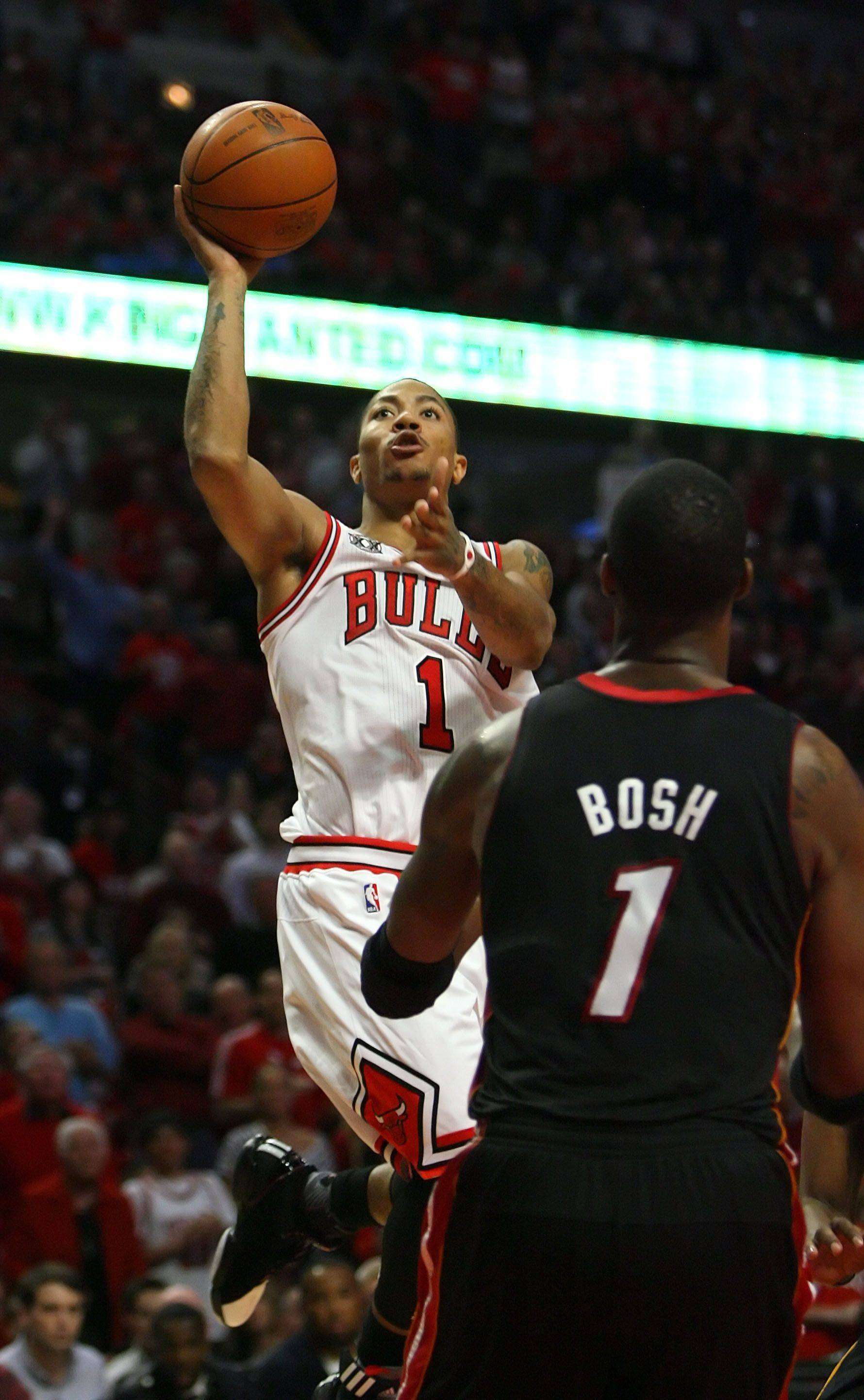 Chicago Bulls point guard Derrick Rose drives on Miami Heat power forward Chris Bosh during game one.