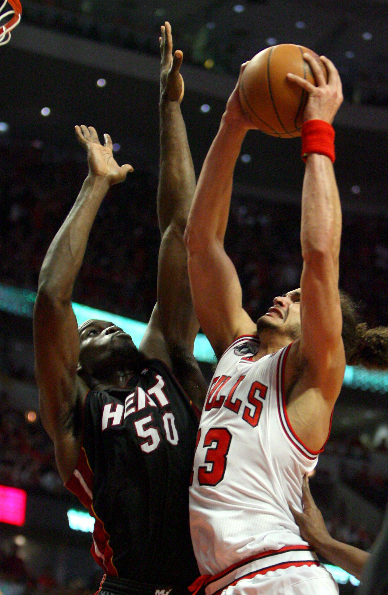 Chicago Bulls center Joakim Noah goes in for a dunk on Miami Heat center Joel Anthony.