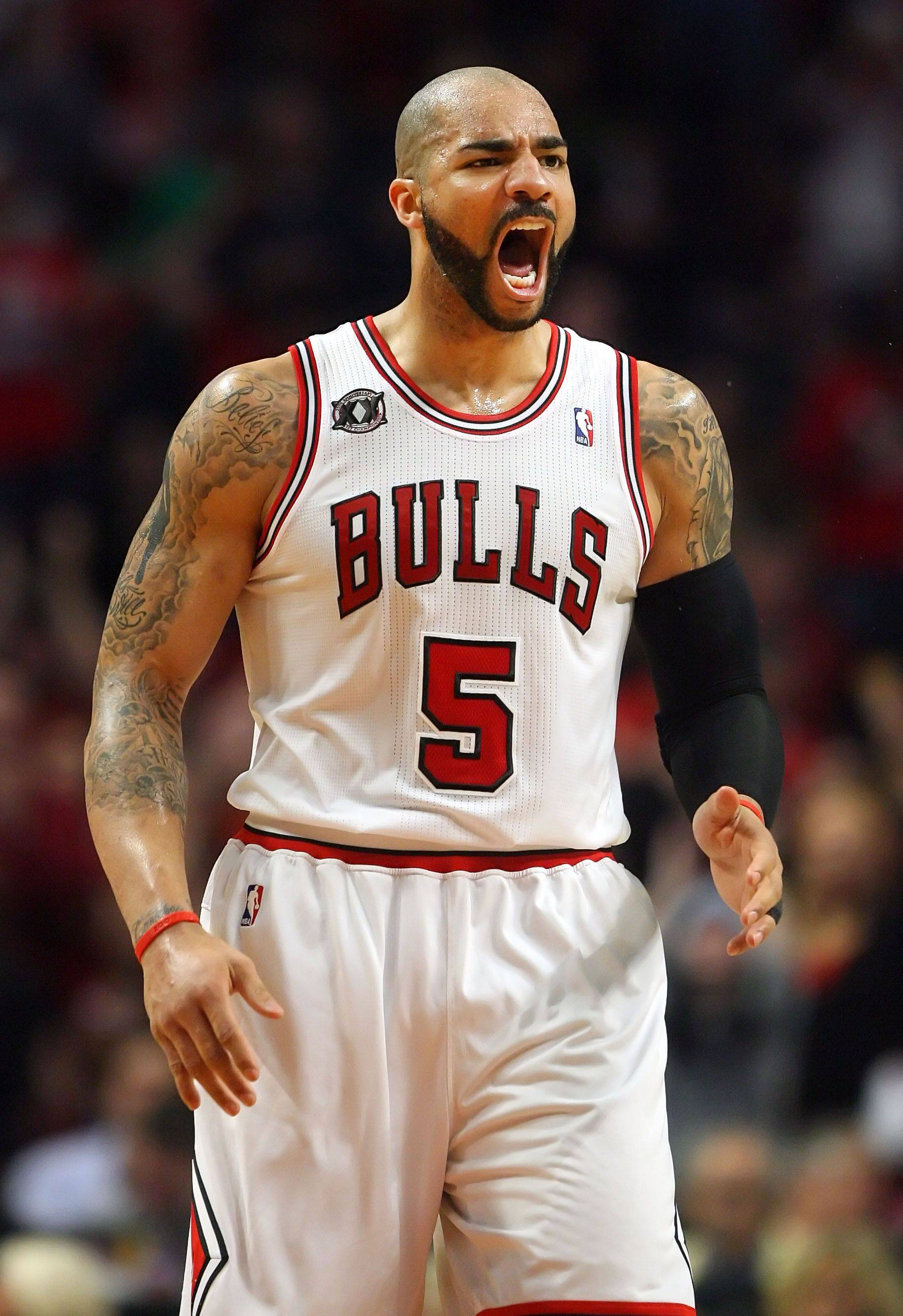 Chicago Bulls power forward Carlos Boozer cheers during game one of the Eastern Conference finals Sunday night at the United Center.