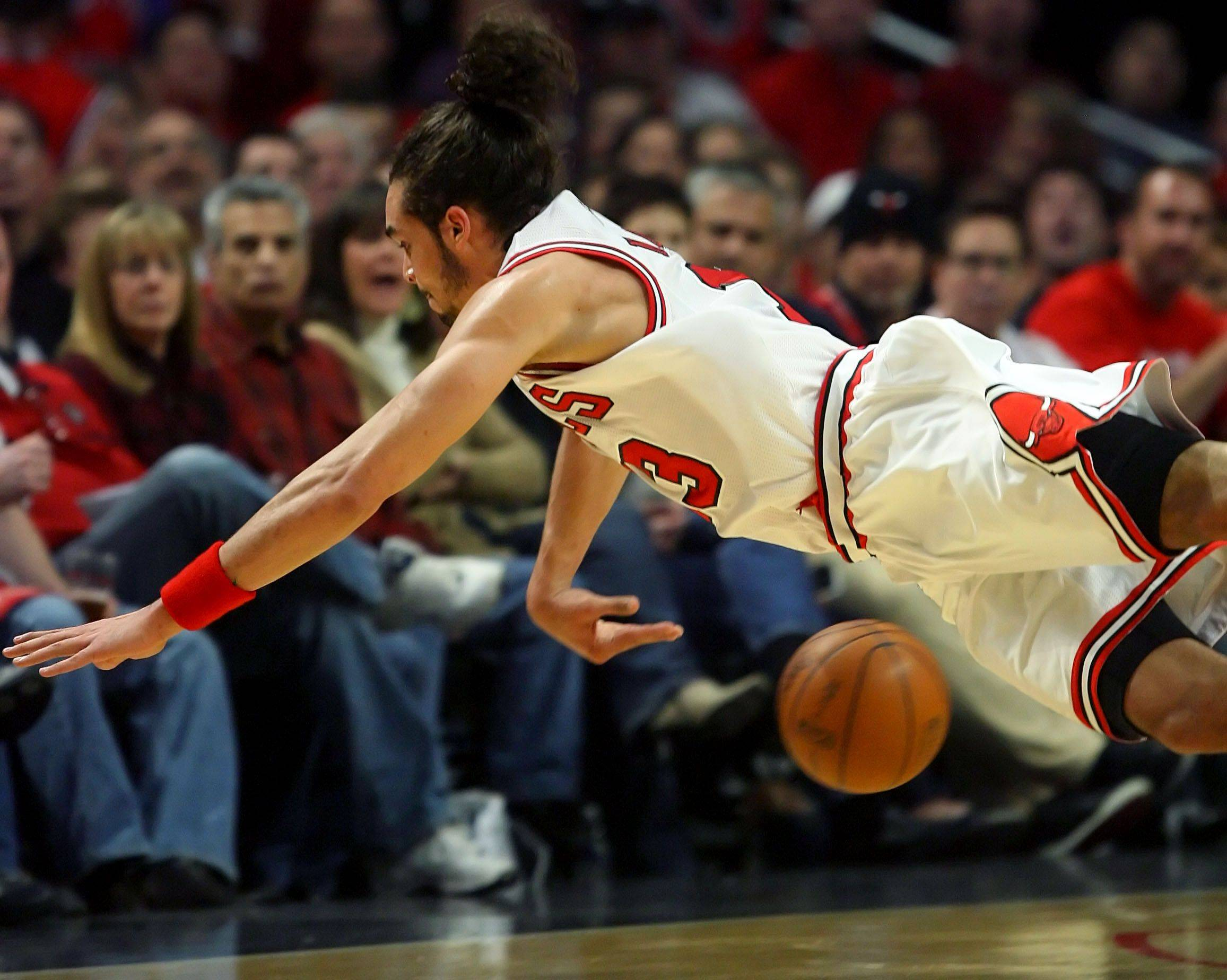 Chicago Bulls center Joakim Noah dives for a ball going out of bounds.