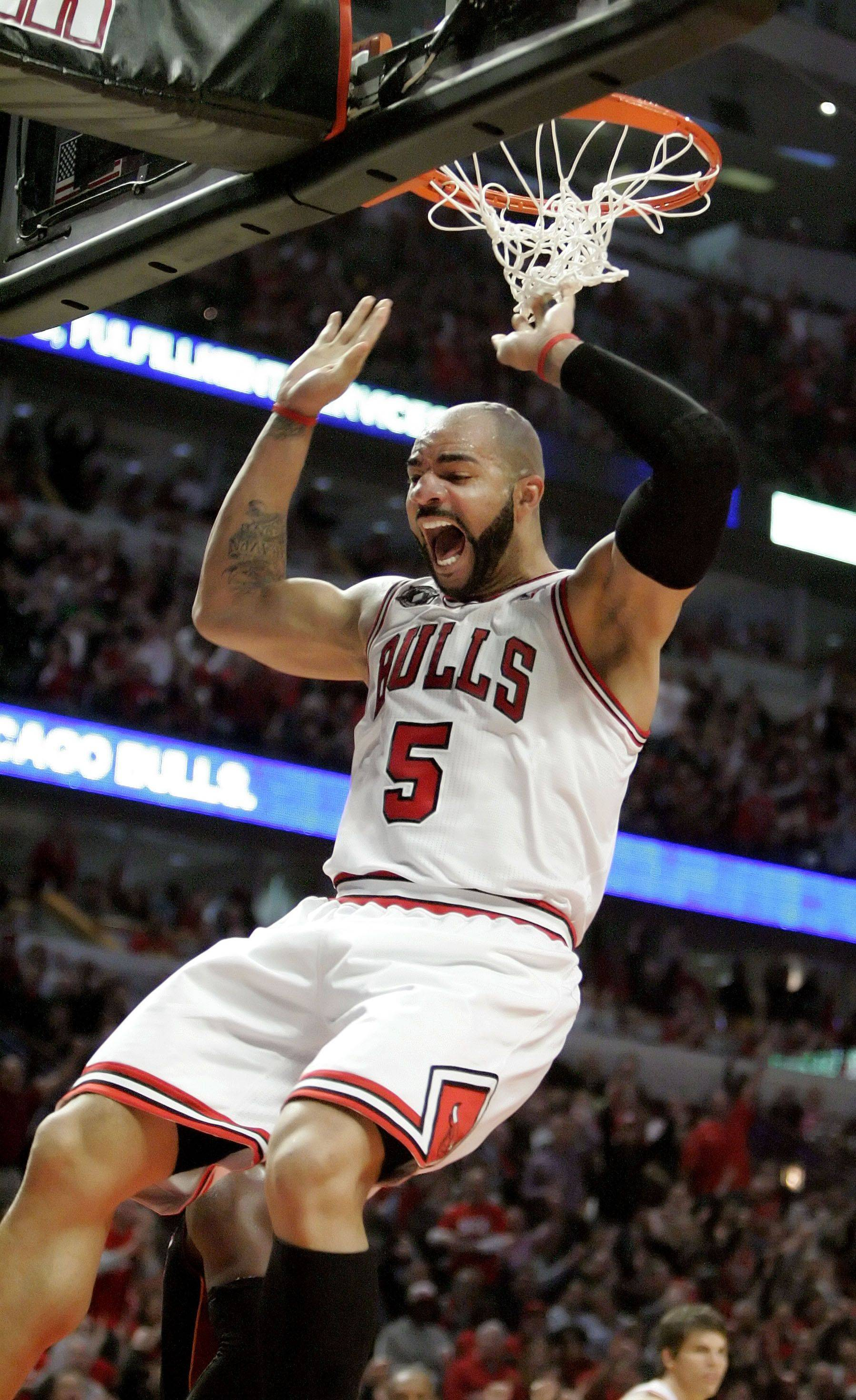 Chicago Bulls power forward Carlos Boozer cheers after a dunk during game one of the Eastern Conference finals.