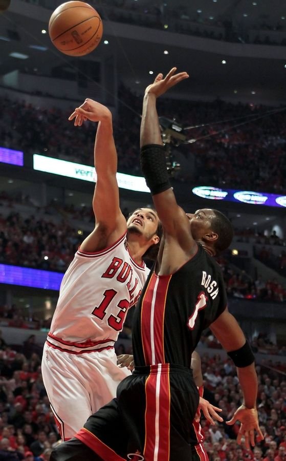 Chicago Bulls center Joakim Noah and Miami Heat power forward Chris Bosh battle for a rebound during game one of the Eastern Conference finals Sunday night at the United Center.