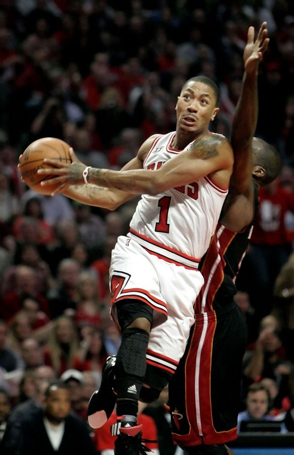 Chicago Bulls point guard Derrick Rose drives on Miami Heat center Joel Anthony during game one of the Eastern Conference finals Sunday night at the United Center.