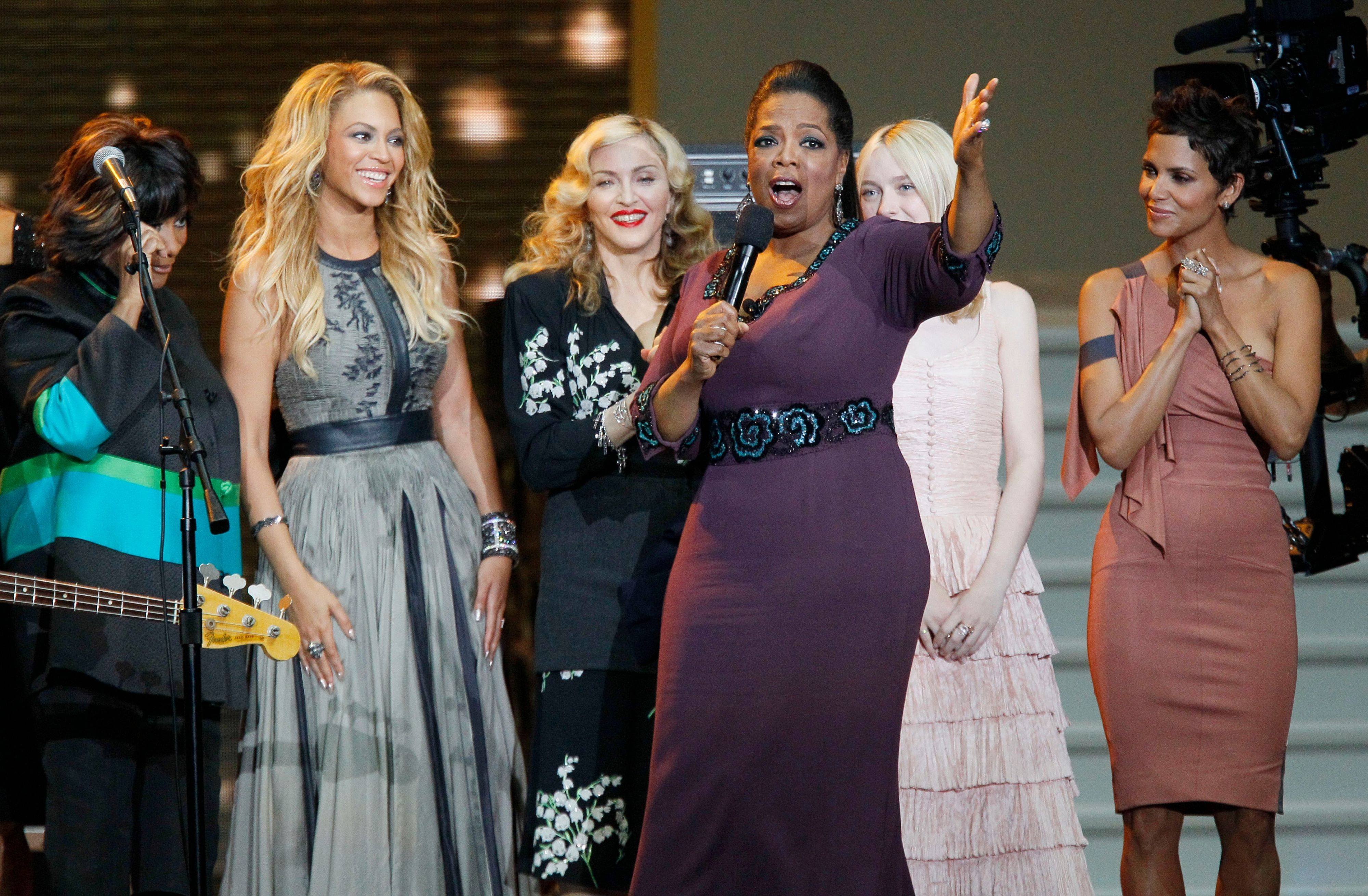 Oprah Winfrey speaks as she is surrounded by, from left, Patti LaBelle, BeyoncÈ, Madonna, Dakota Fanning and Halle Berry.